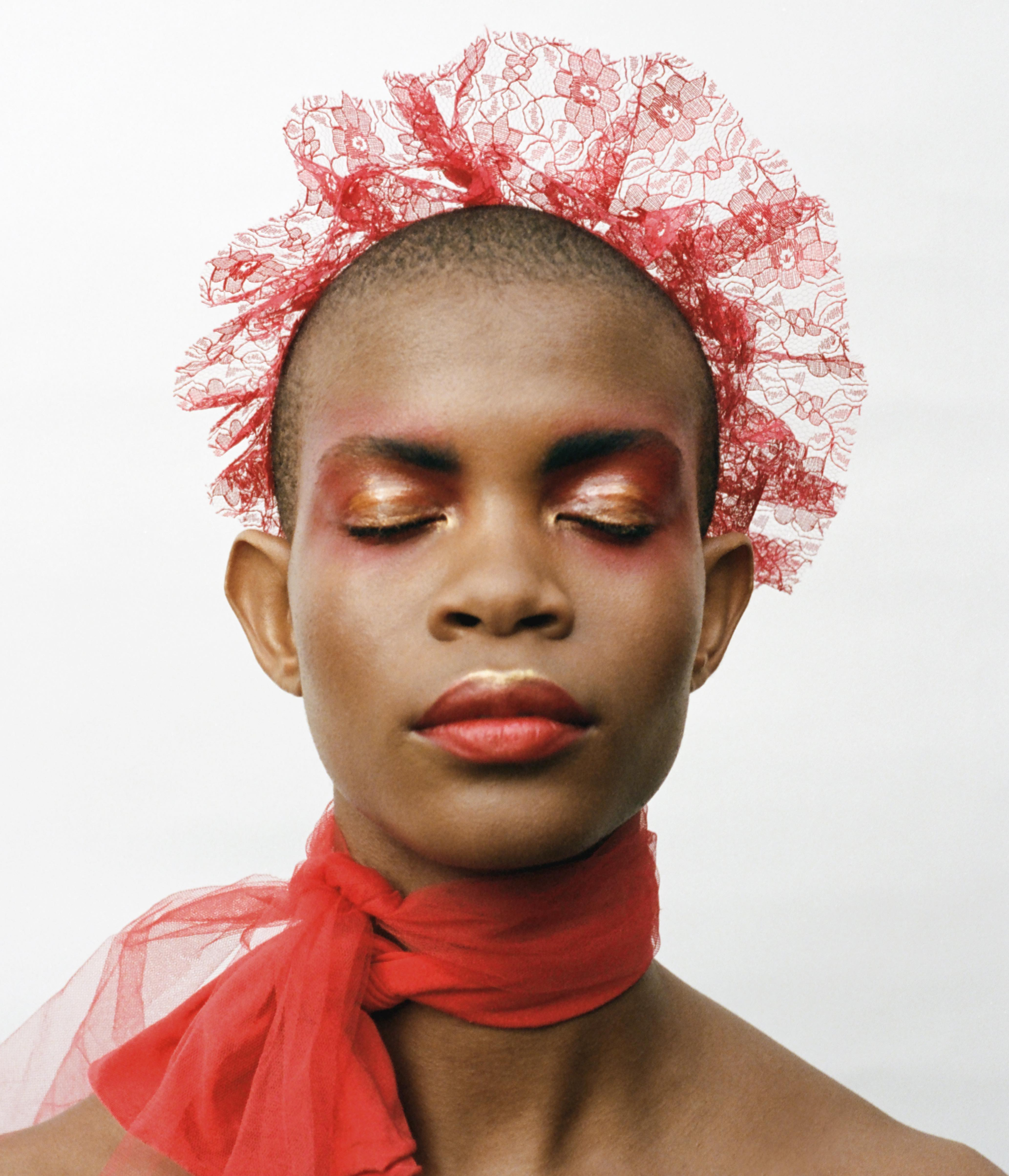 Maximalisme de Chanel beauty editorial in magazine red scarf