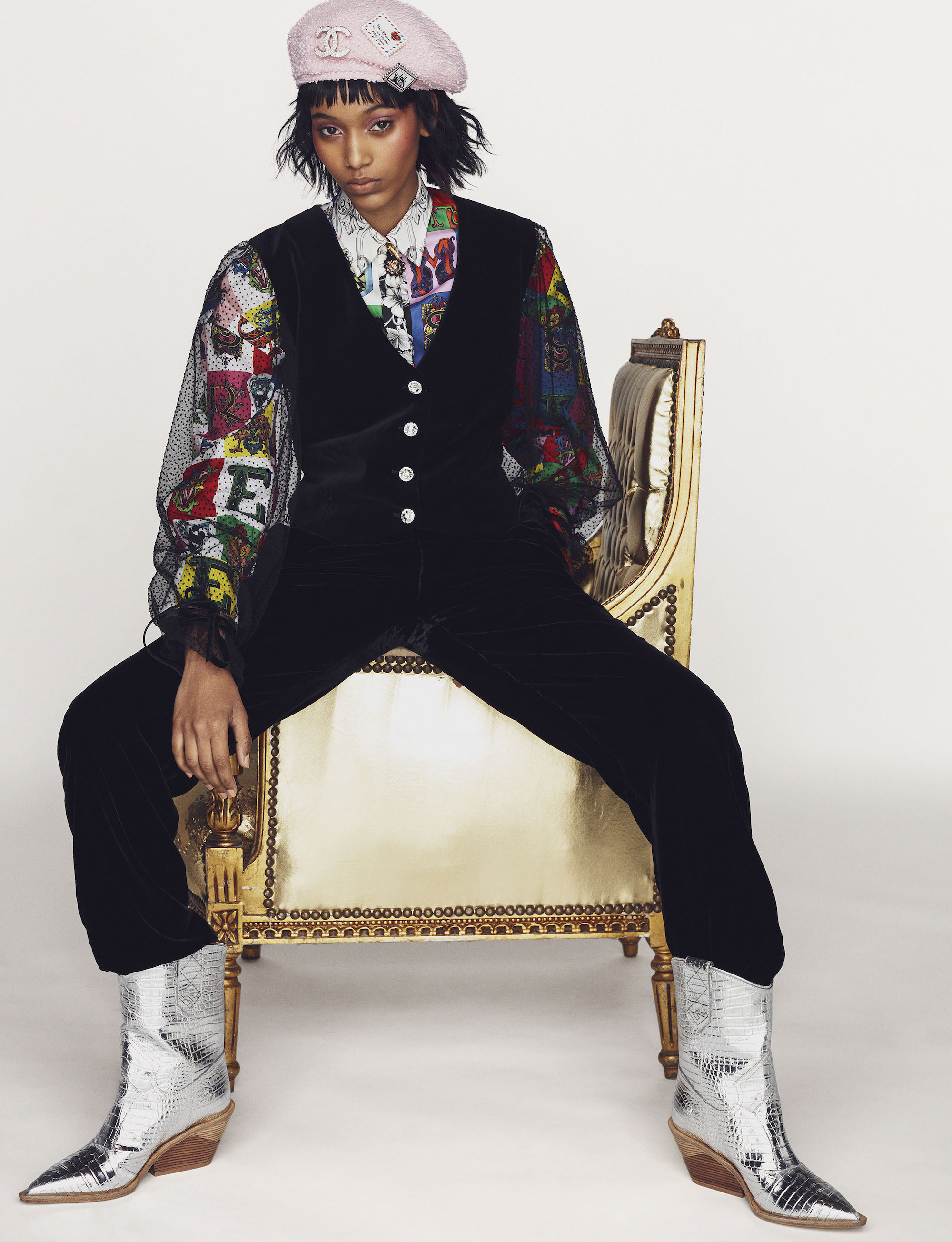 Main fashion editorial in Winter 18/19 issue model in gold chair