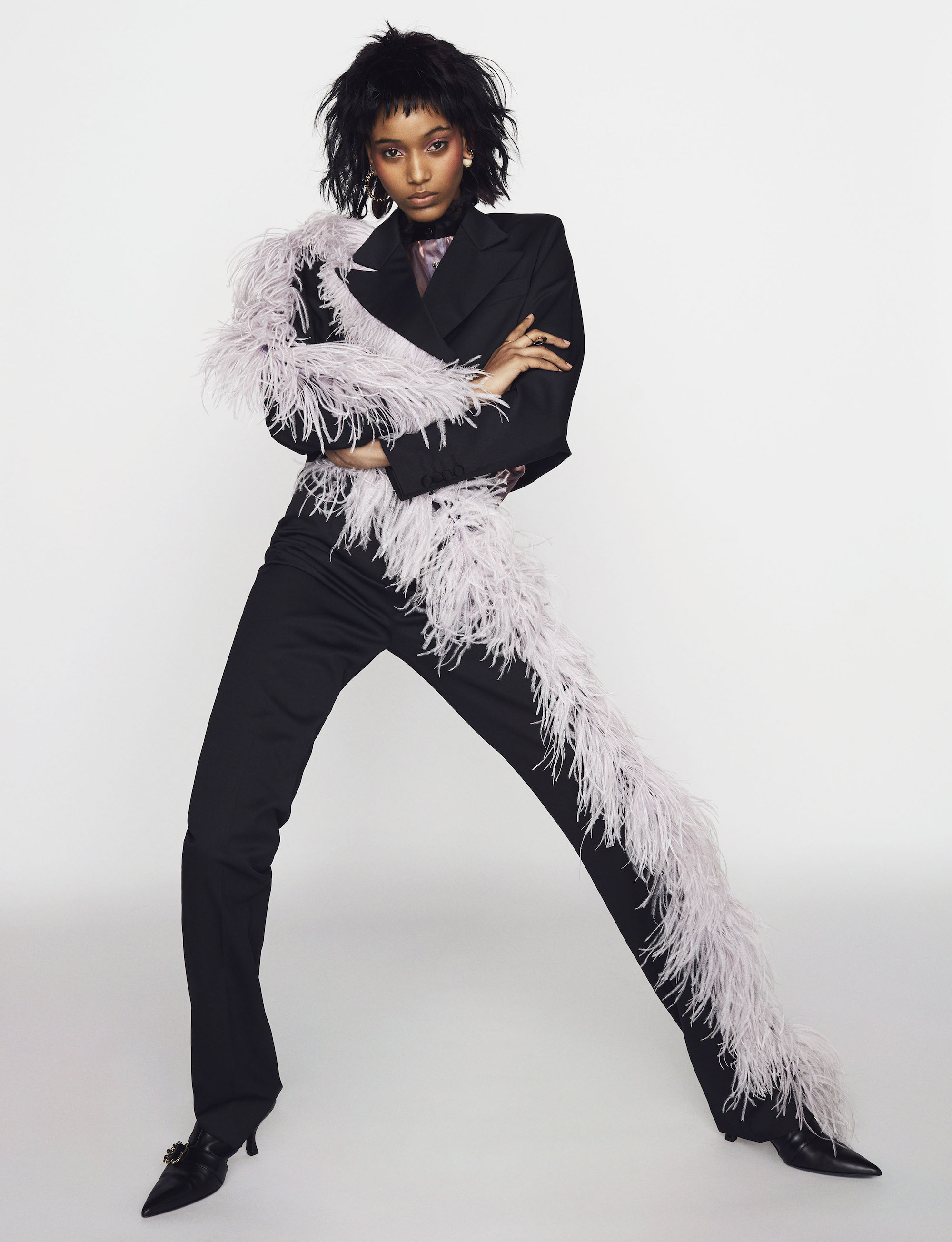 Main fashion editorial in Winter 18/19 issue model in feather suit