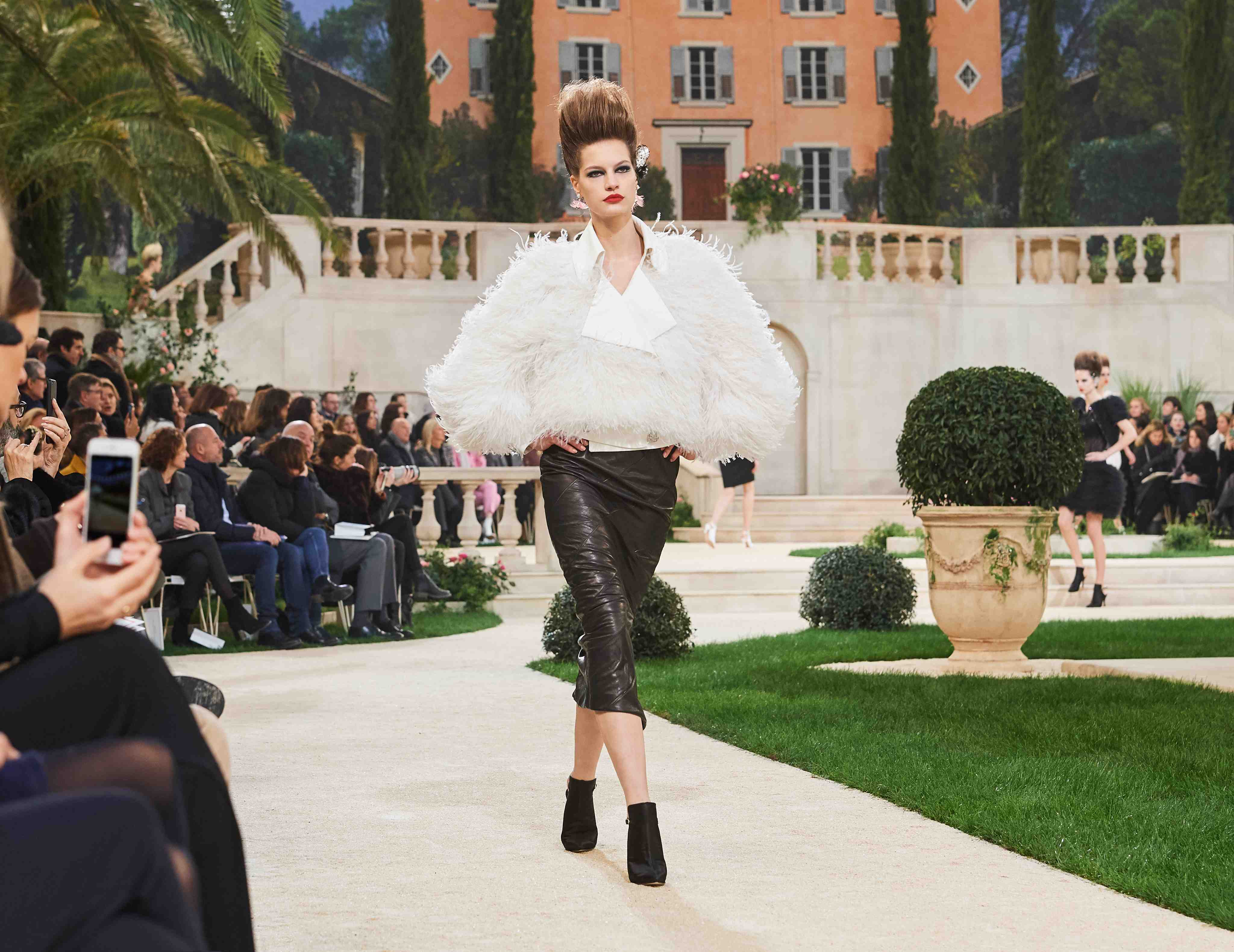 Chanel SS19 Haute Couture black leather skirt and feathered white jacket