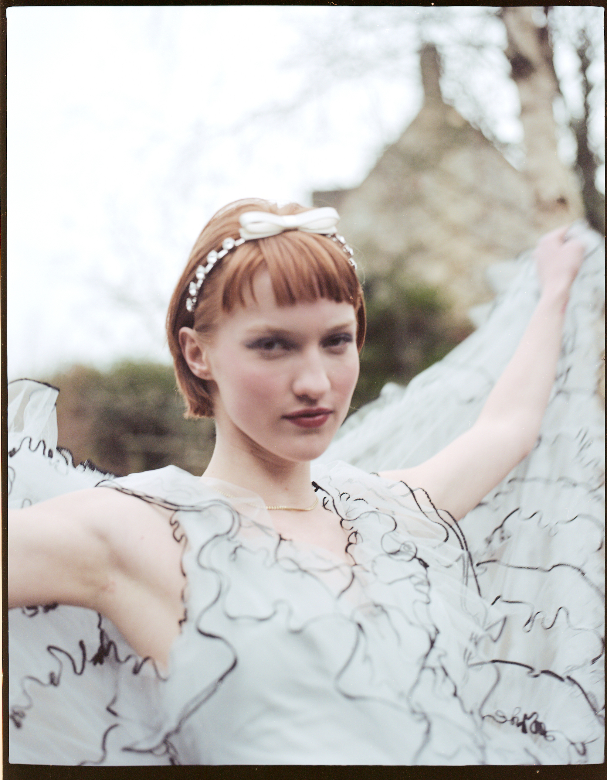 Wuthering heights fashion editorial in the Spring 19 issue of Wonderland white dress stretched