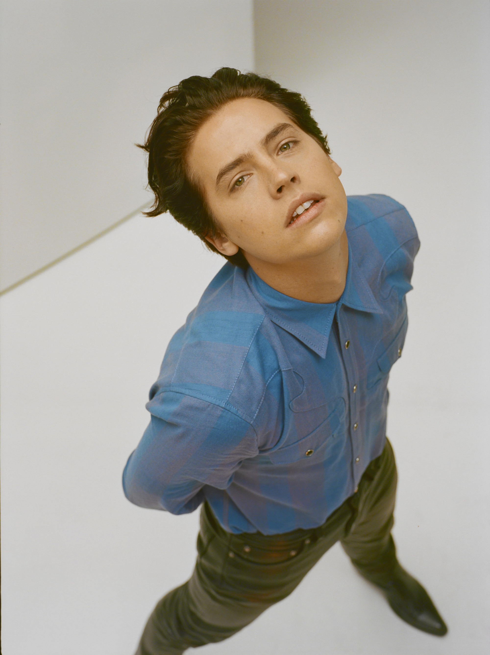 Cole Sprouse on the Spring 19 cover of Wonderland in blue shirt