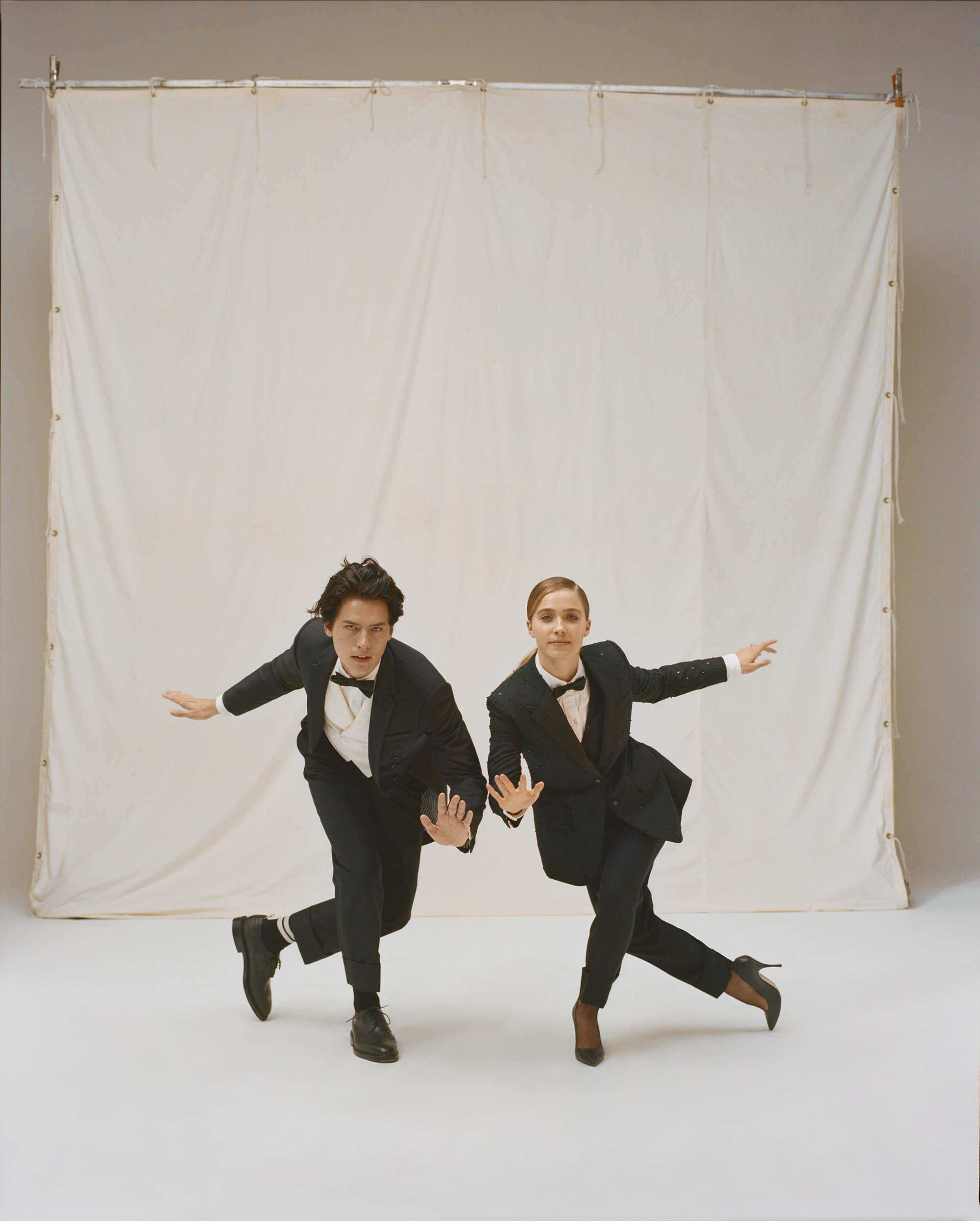 Cole Sprouse and Haley Lu Richardson on the Spring 19 cover of Wonderland in tuxedo's dancing