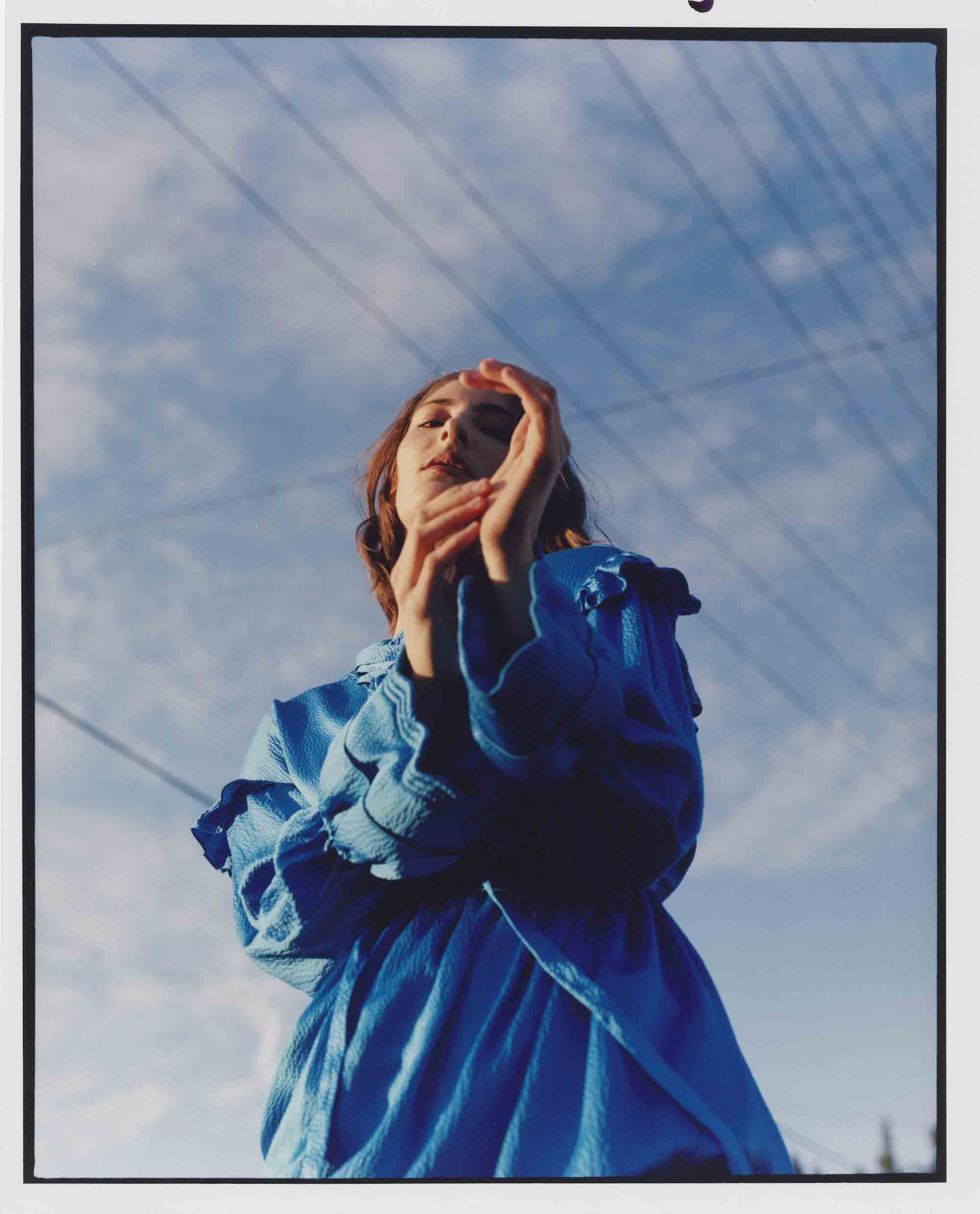 Perfect day fashion editorial in Spring 19 issue of Wonderland blue dress