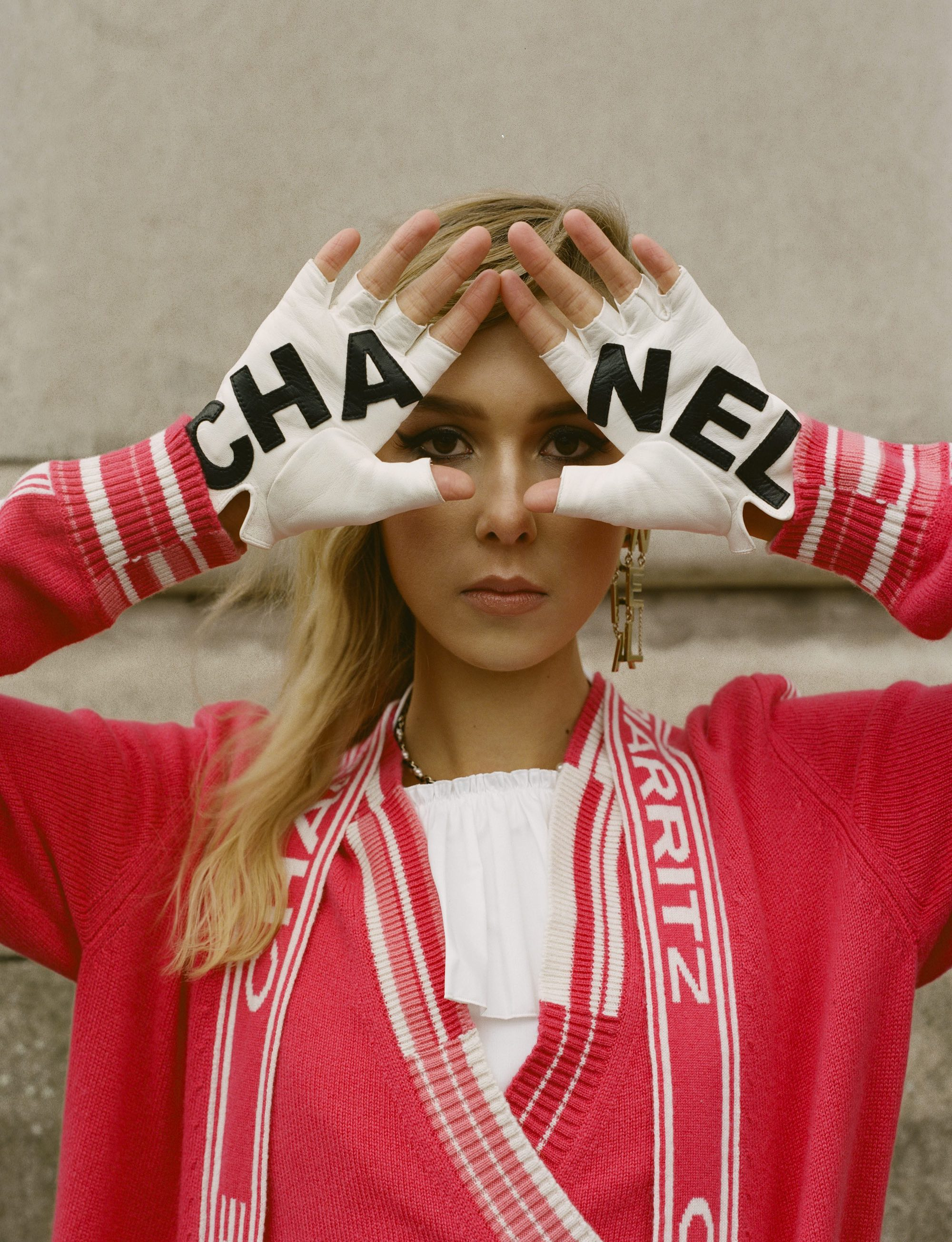 Chanel SS19 fashion editorial in Wonderland Spring 19 issue red jumper