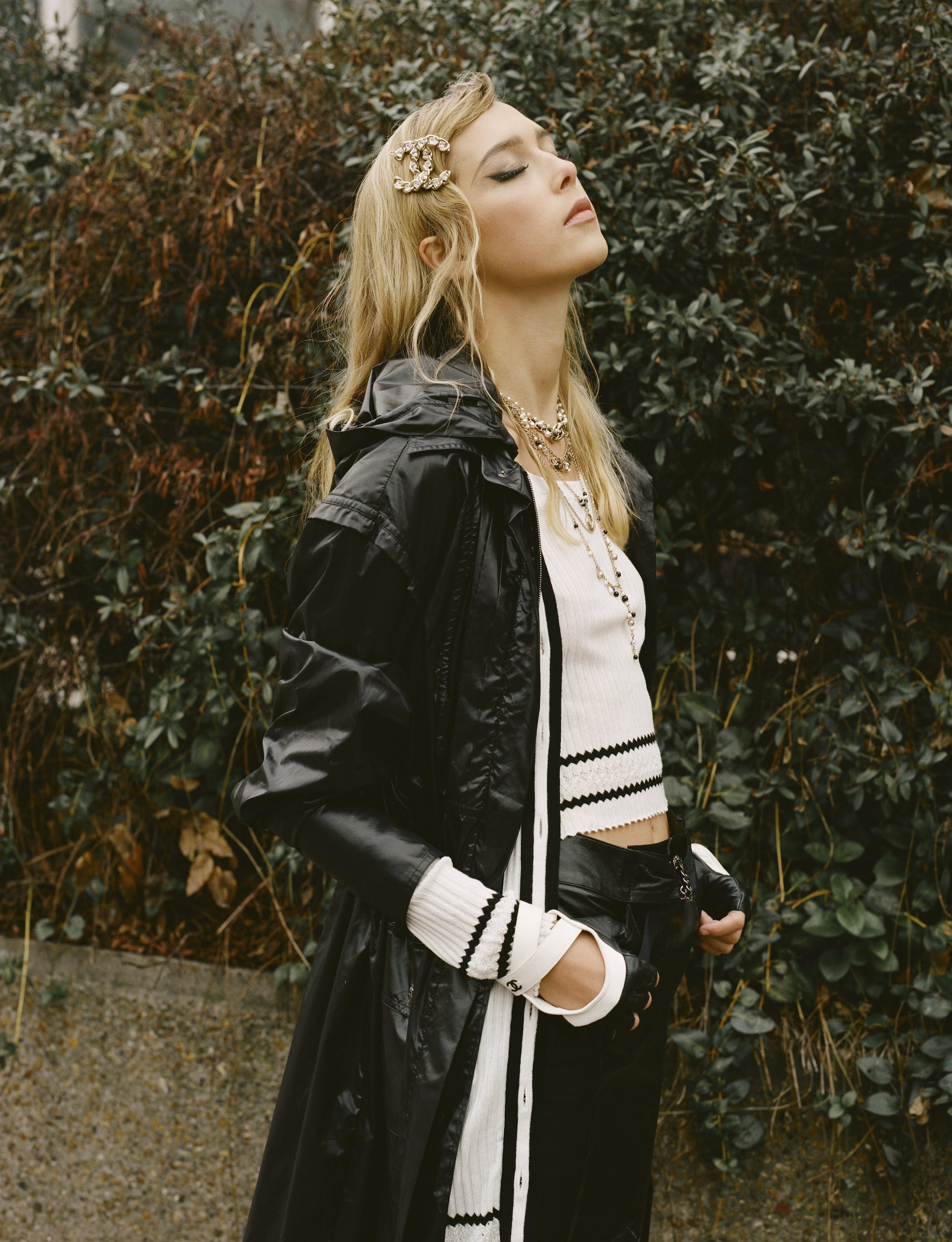 Chanel SS19 fashion editorial in Wonderland Spring 19 issue rain jacket