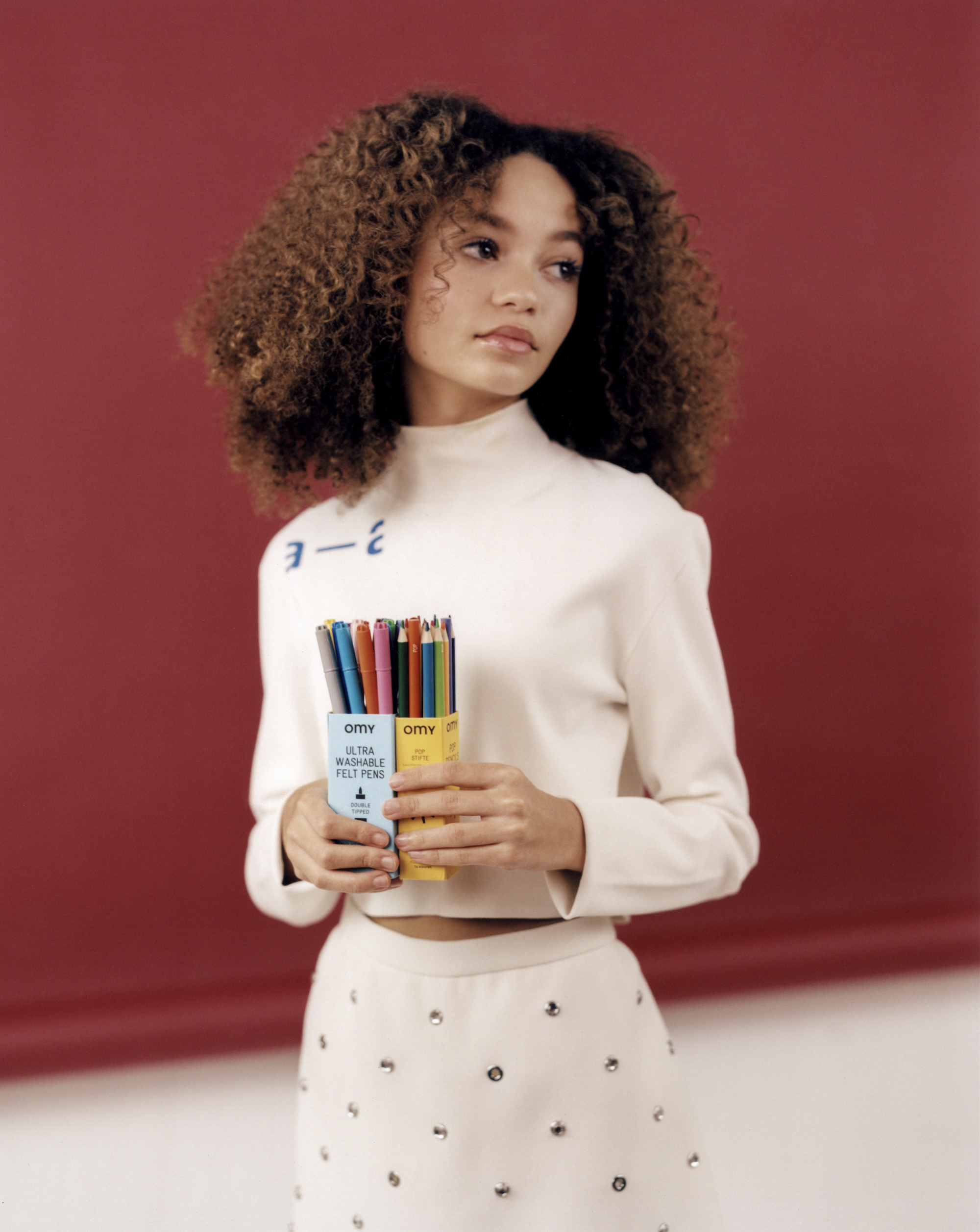 Thandie Newton's daughter Nico Parker, star of Dumbo in Wonderland's Spring 19 issue in white dress