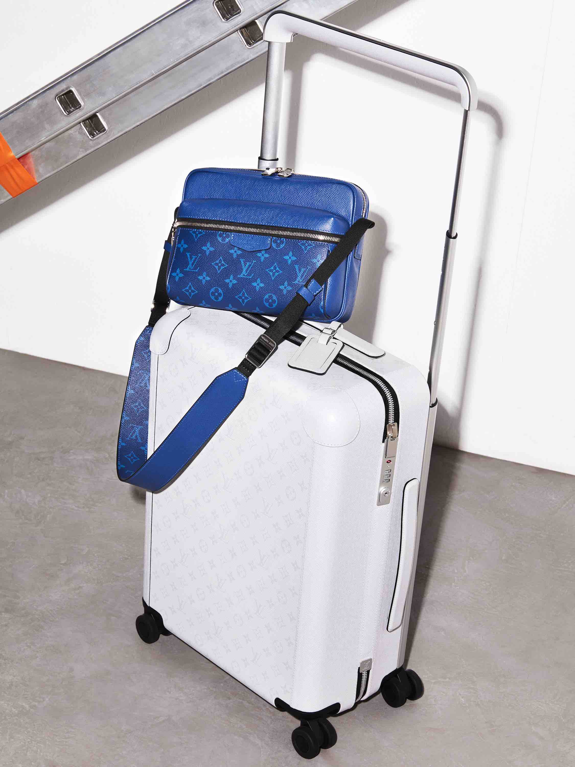Louis Vuitton Taigarama Collection white suitcase and blue crossover bag