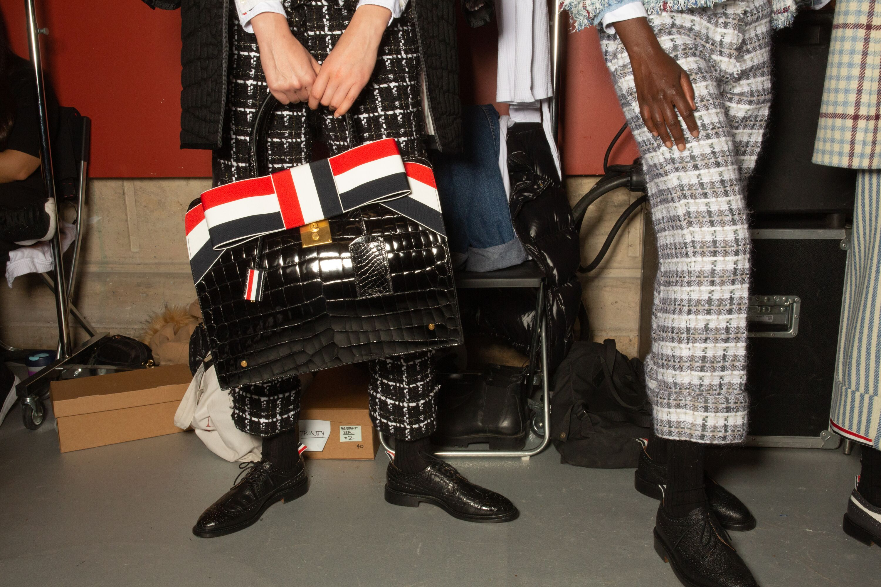 Thom Browne embellished check trousers and bow croc handbag aw19