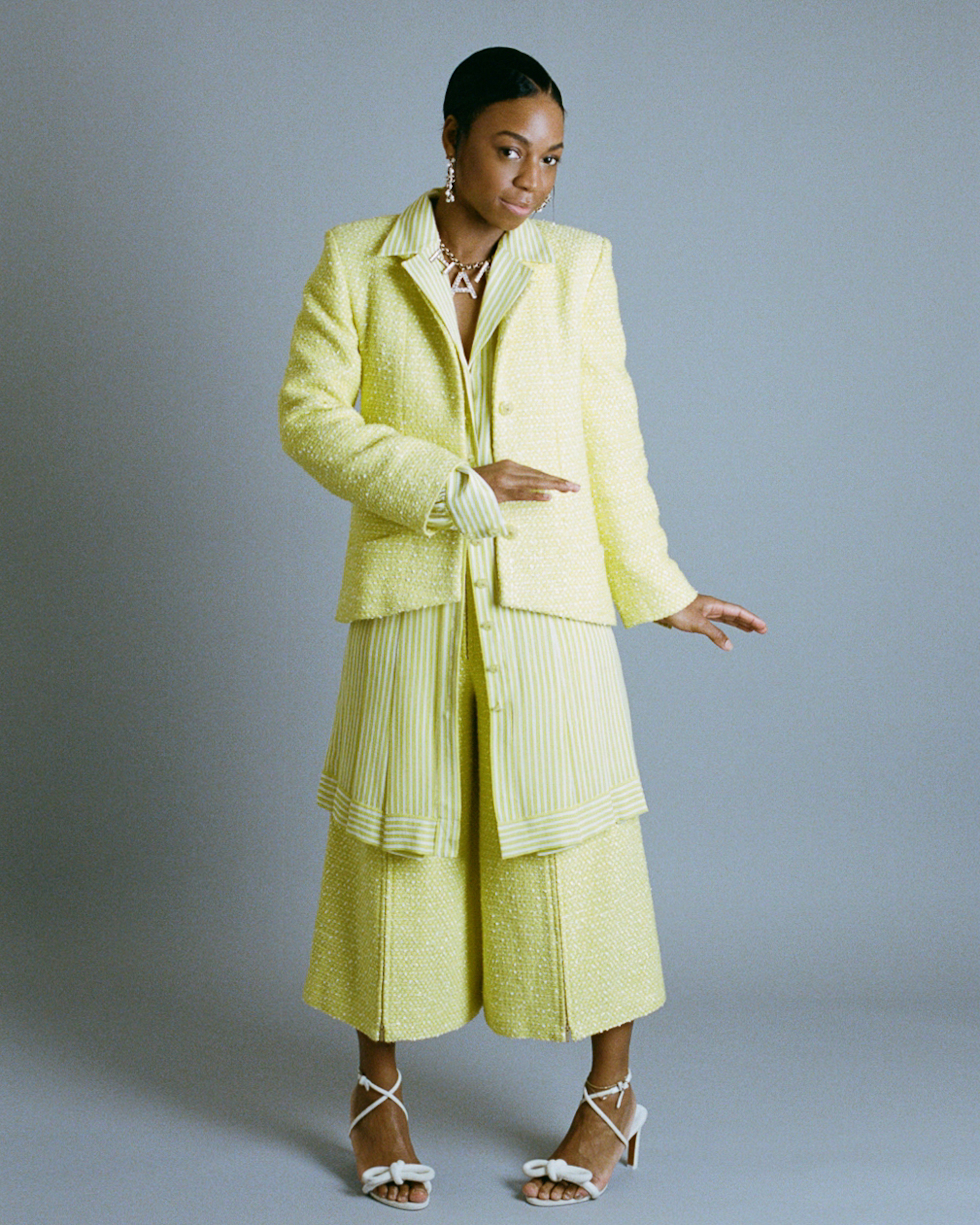 Pippa Bennett-Warner in yellow suit full-length