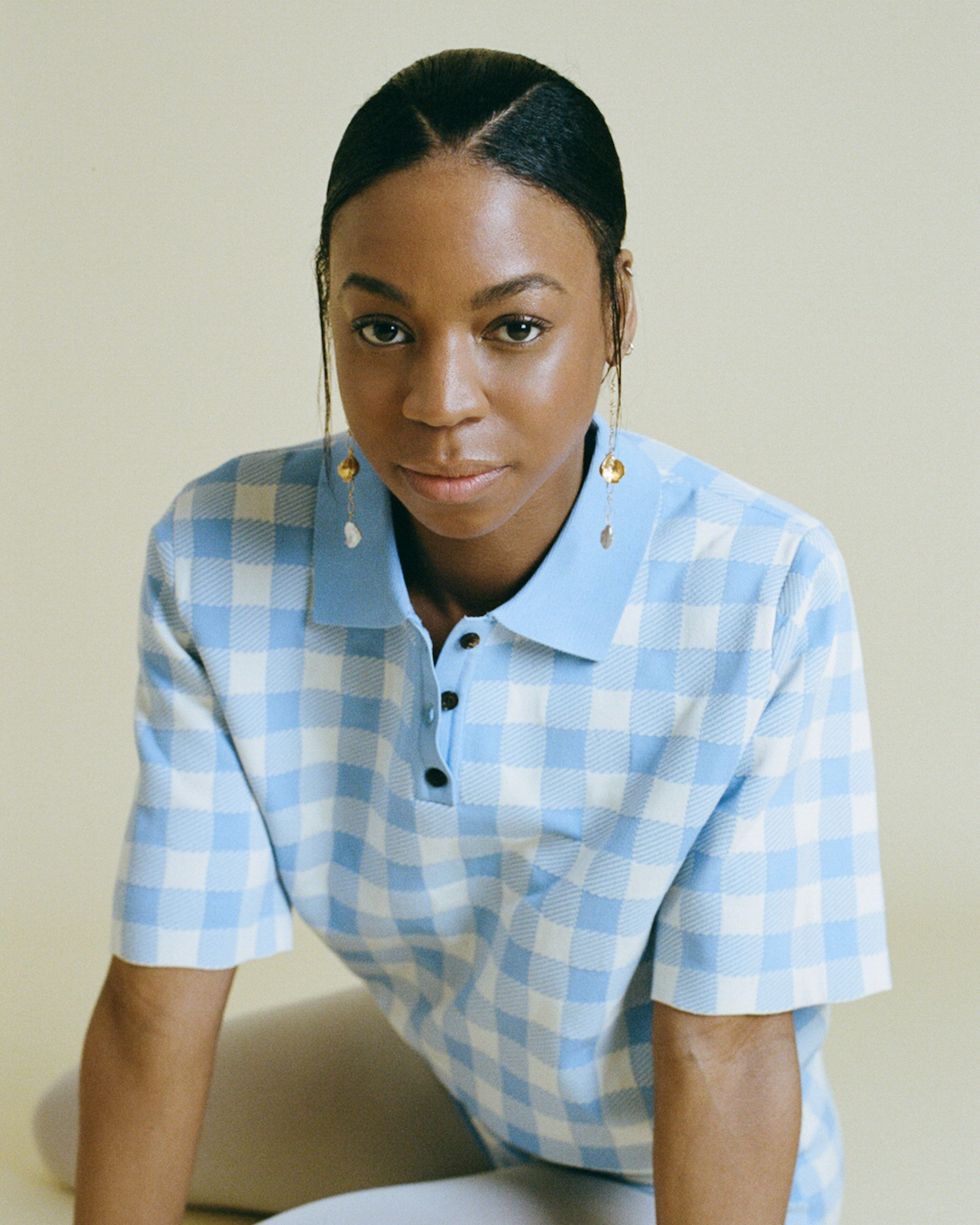 Pippa Bennett-Warner in yellow suit full-length blue gingham