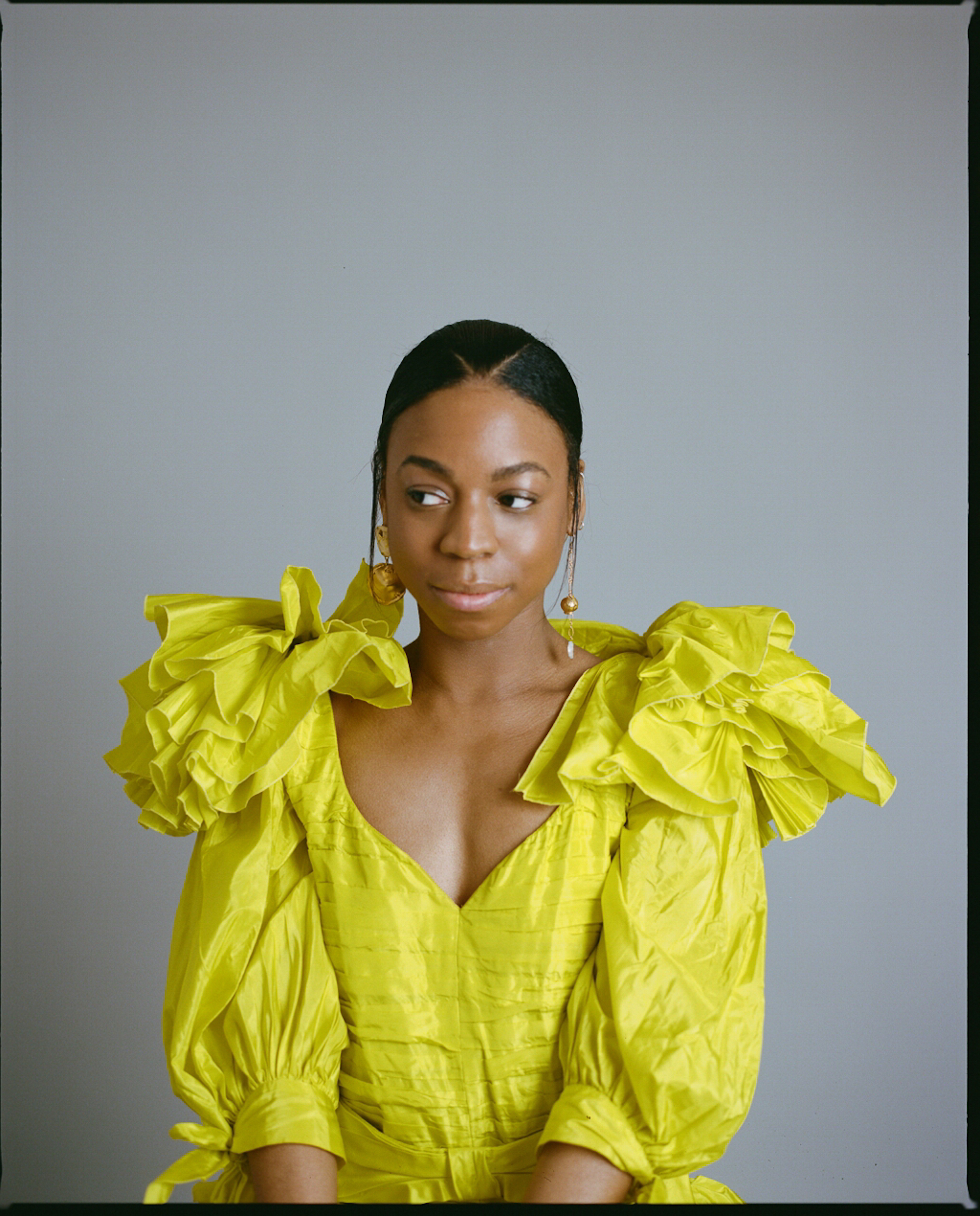 Pippa Bennett-Warner in yellow ruffle top