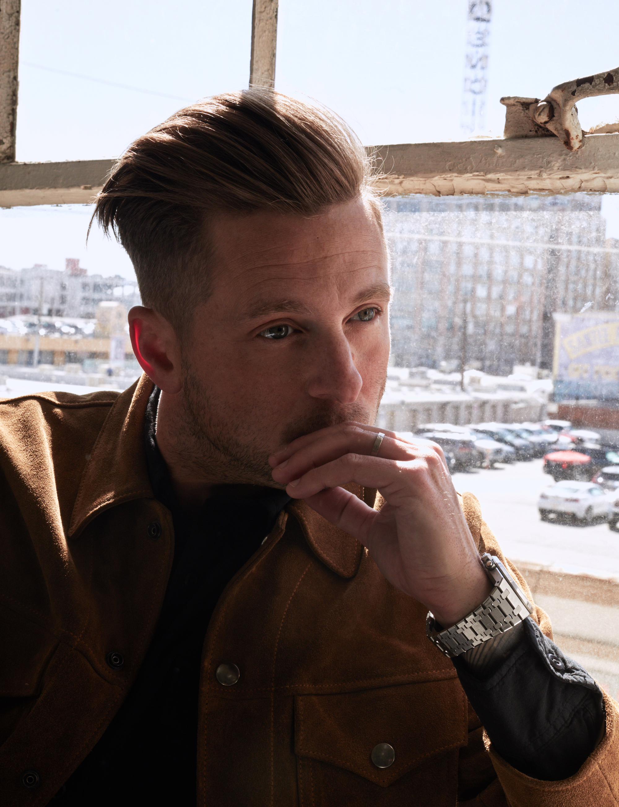 Ryan Tedder, frontman of OneRepublic, interview with Wonderland closeup by window