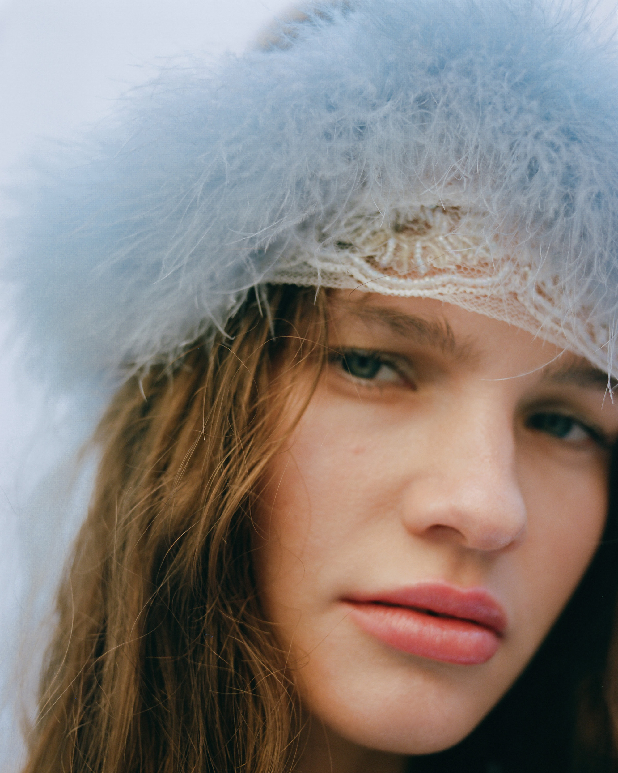 A fine line fashion editorial fluffy hat