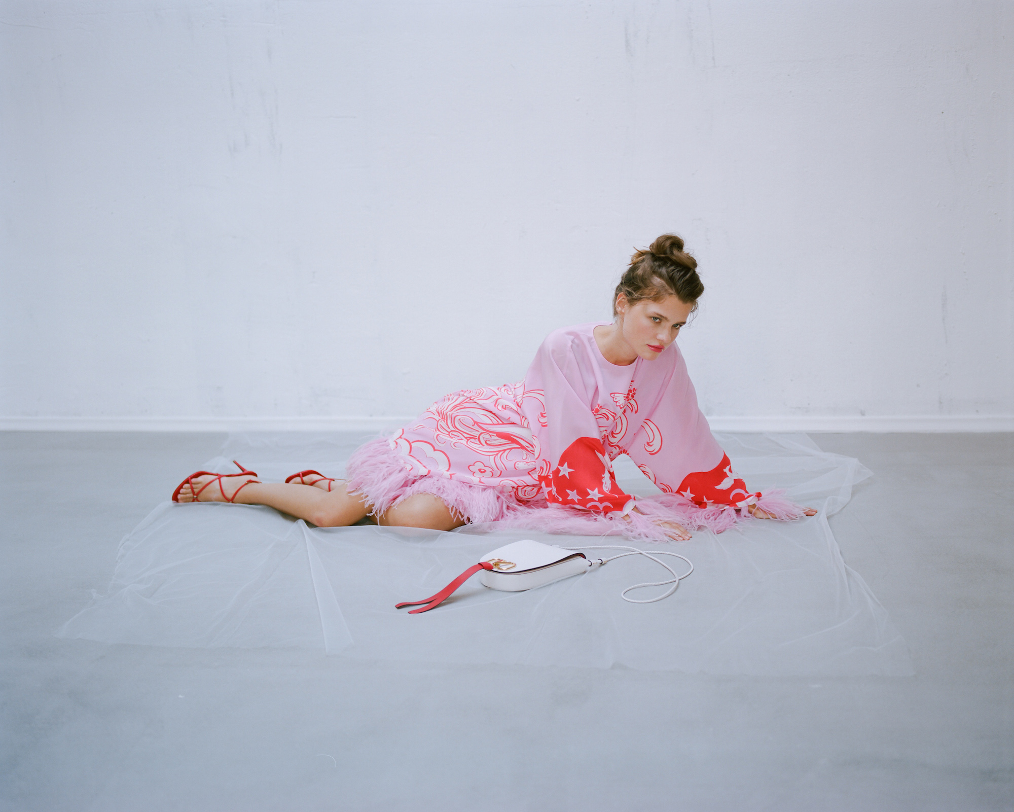 A fine line fashion editorial pink dress