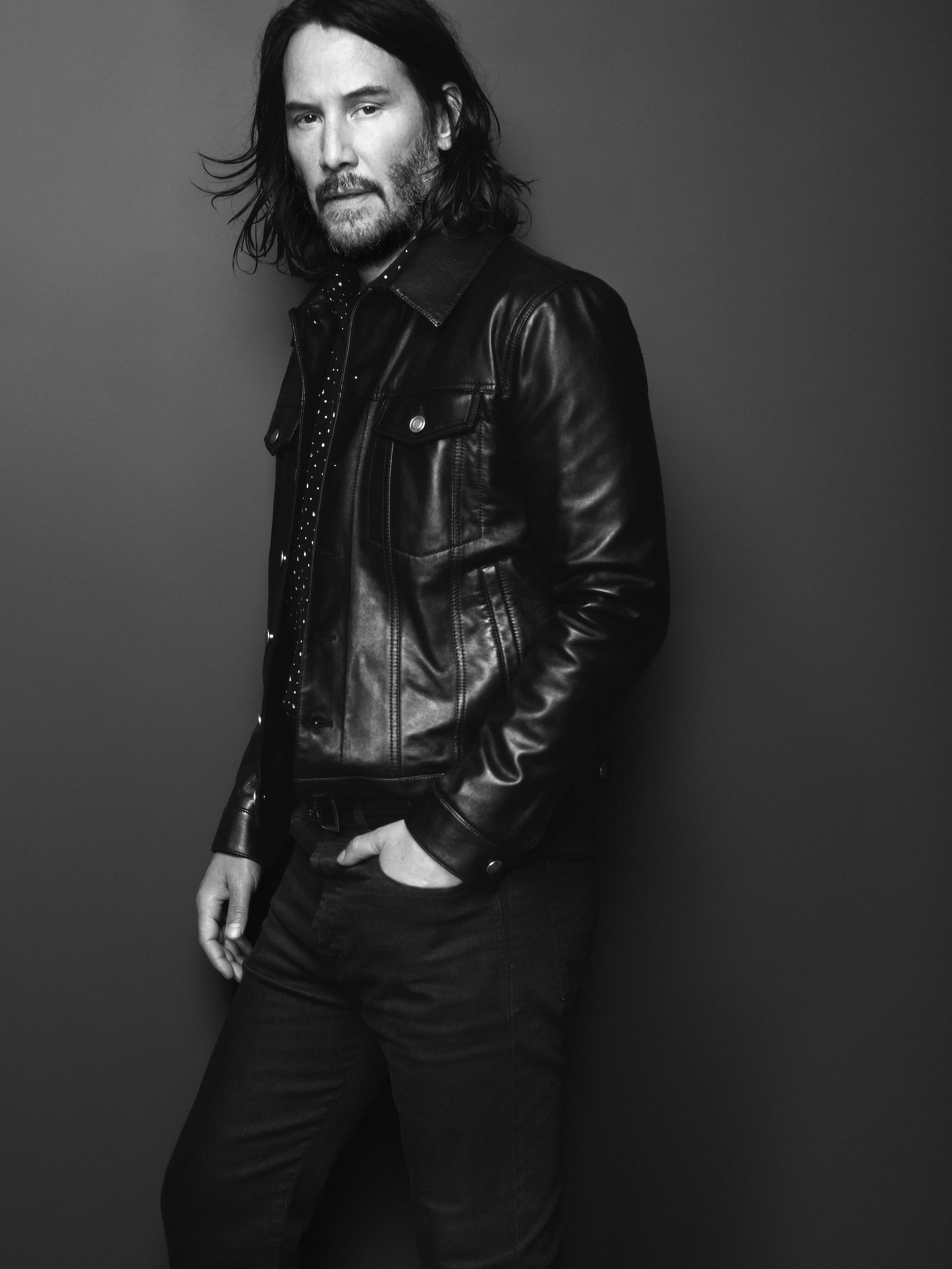Keanu Reeves is the face of Saint Laurent Fall 2019 menswear campaign in a leather jacket