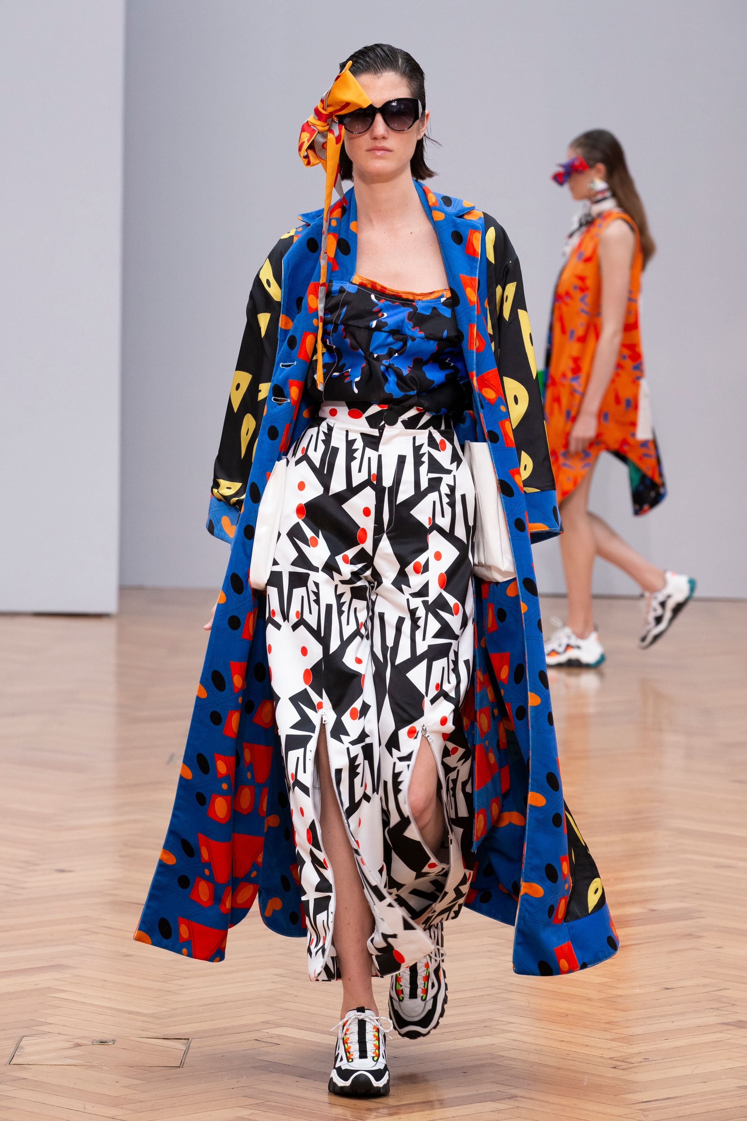 Istituto Marangoni new era fashion show patterned clashing dress