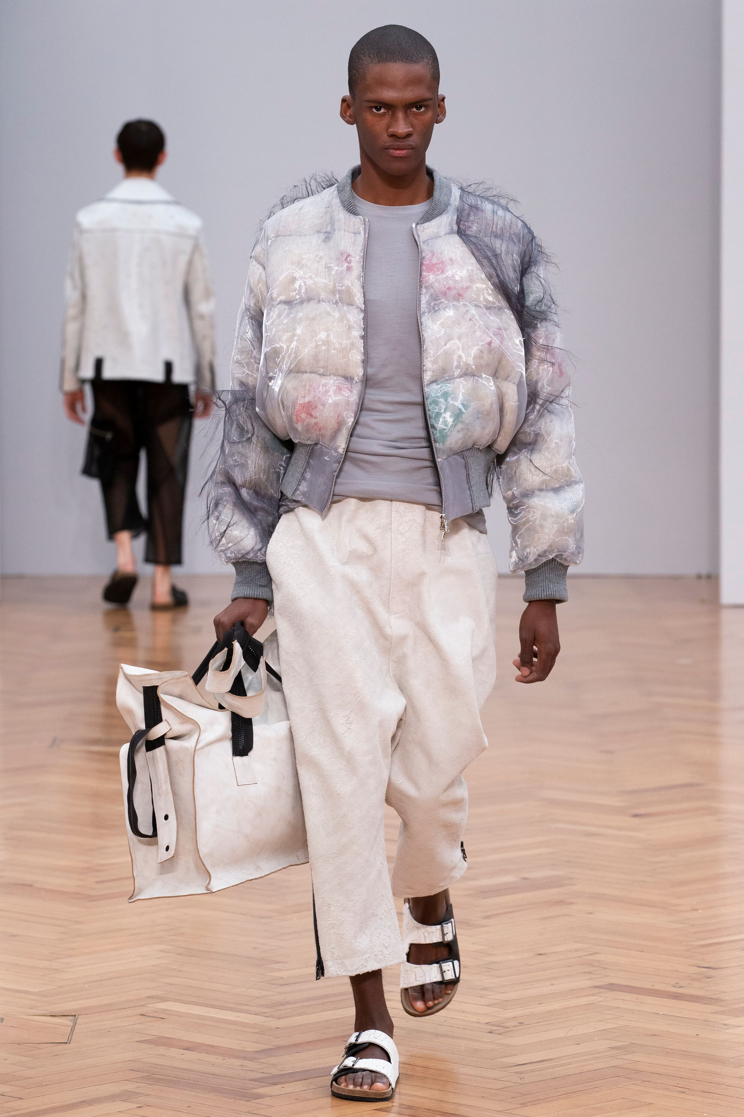 Istituto Marangoni new era fashion show paterned puffer jacket