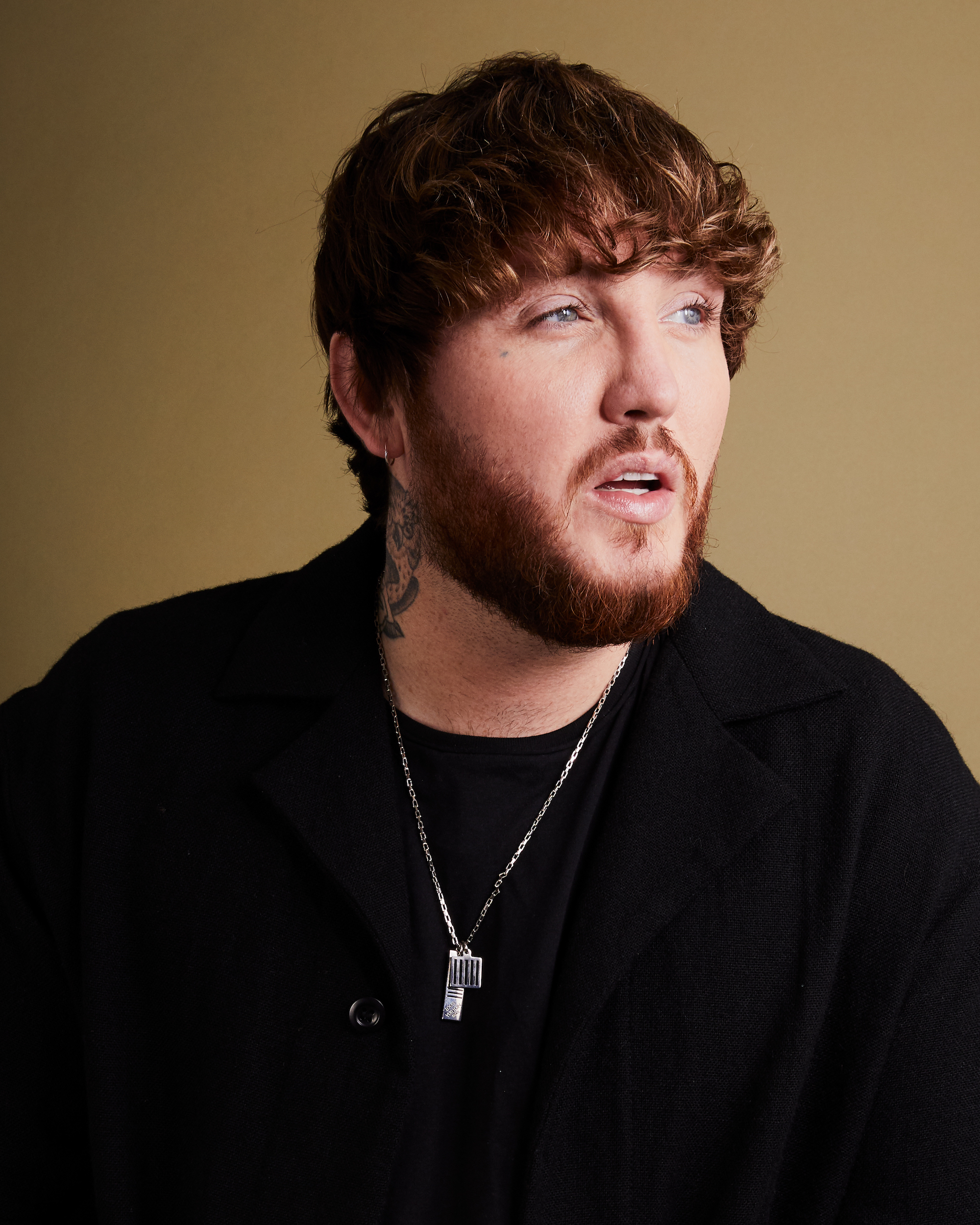 James Arthur black jumper