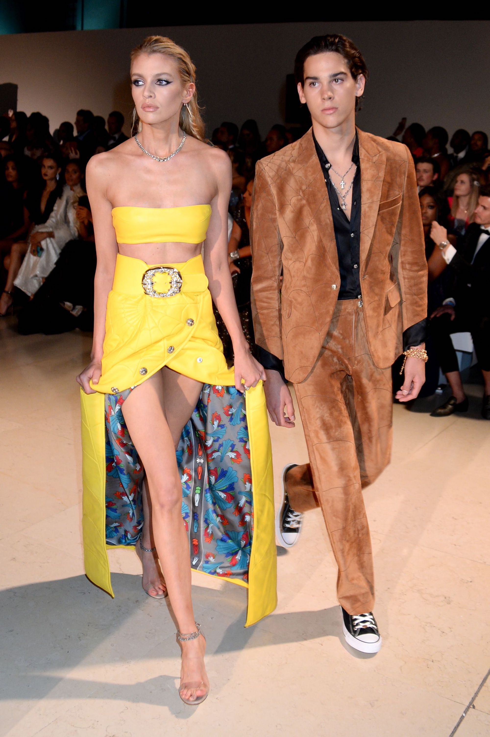 Stella Maxwell and Paris Brosnan wearing bespoke Chrome Hearts on the Fashion for Relief catwalk corner