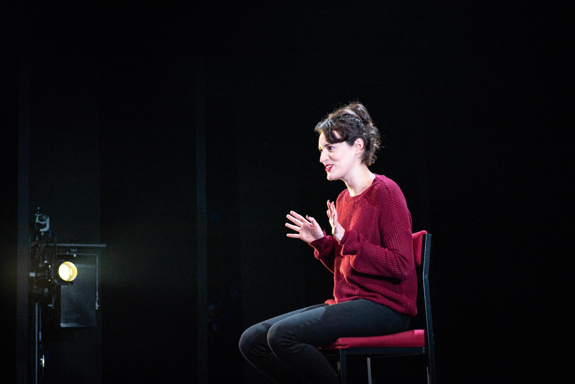 Phoebe Waller-Bridge in London theatre play of Fleabag looking to the side