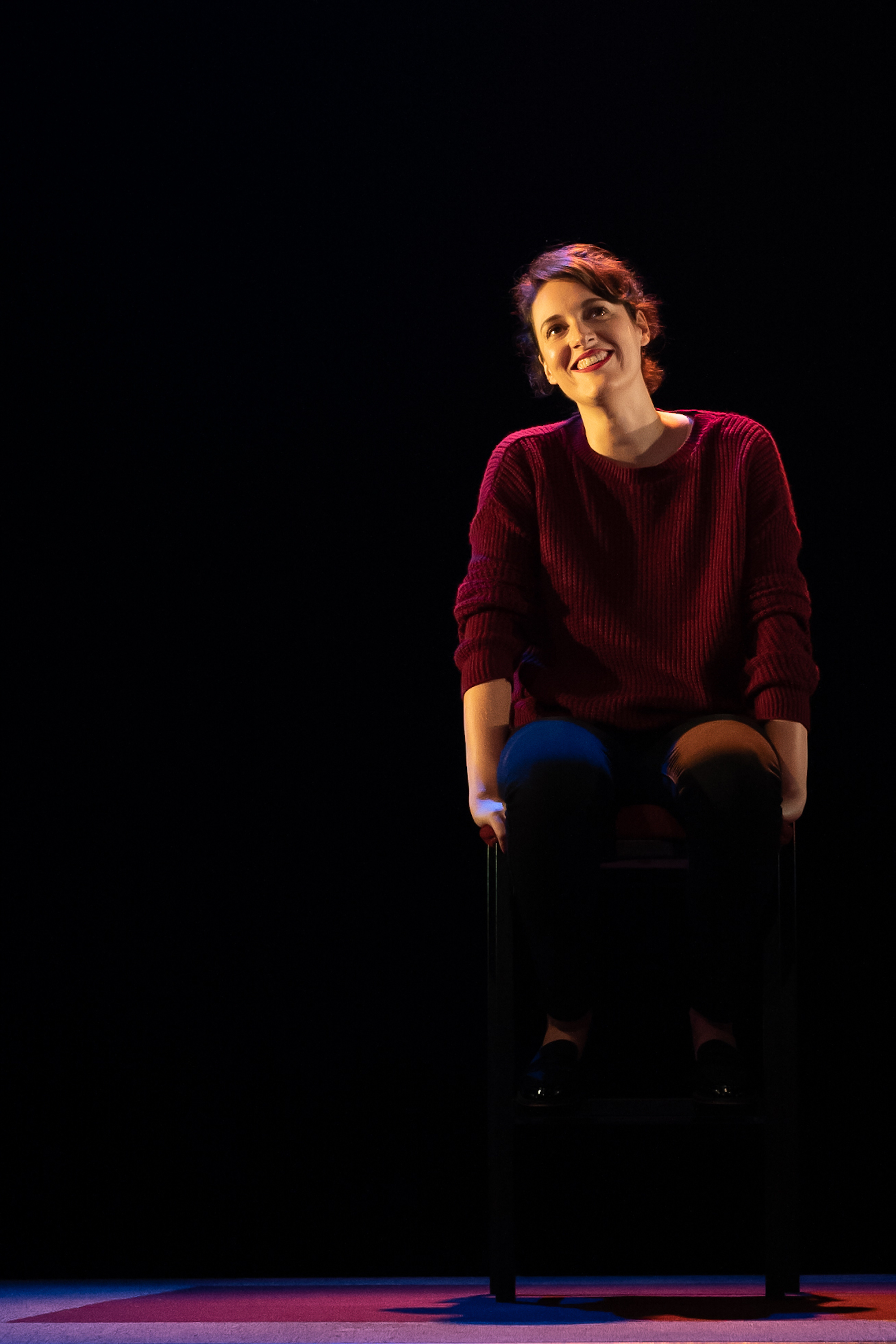 Phoebe Waller-Bridge in London theatre play of Fleabag looking up