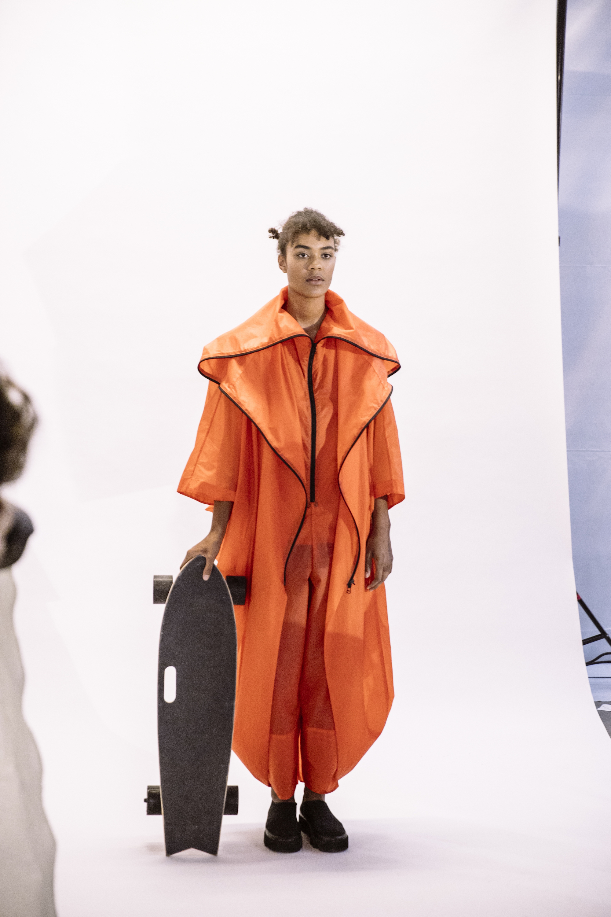 Wonderland Paris Fashion Week Issey Miyake SS20 show orange raincoat