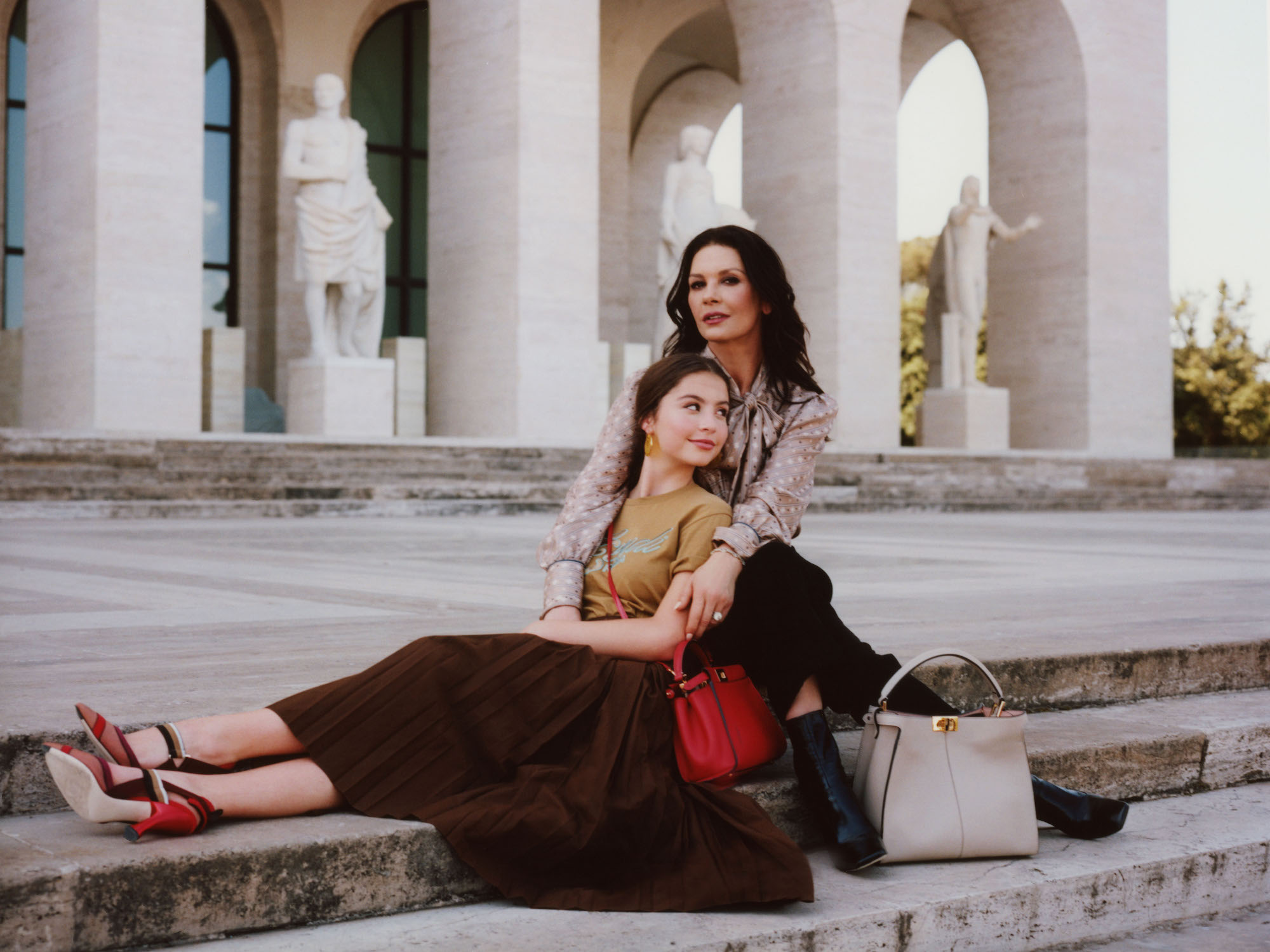 Catherine Zeta-Jones and daughter Carys for Me And My Peekaboo campaign sitting down