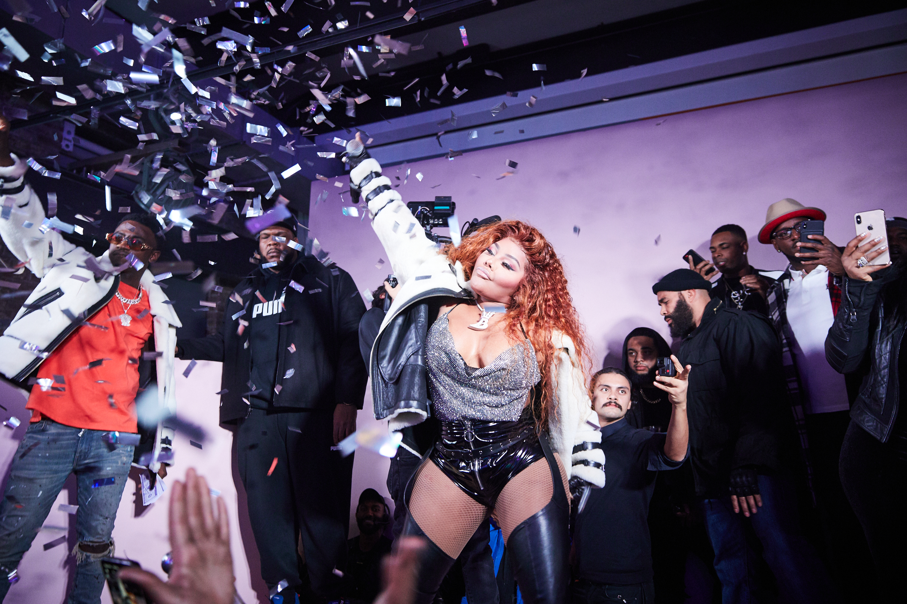 Moose Knuckles Soho Store Opening Lil Kim Mic