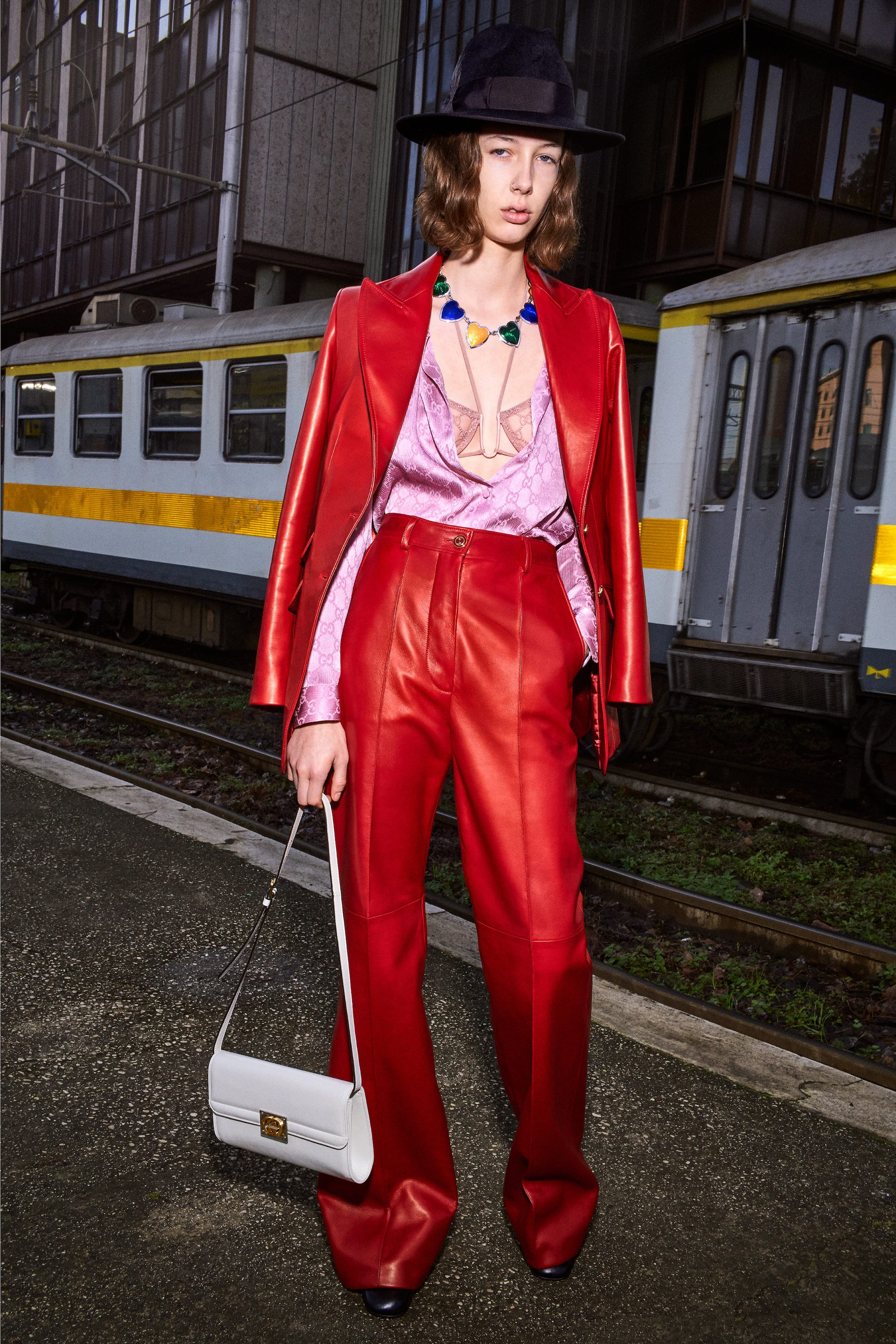 Gucci Pre Fall 2020 Lookbook shot by Bruce Gilden red suit