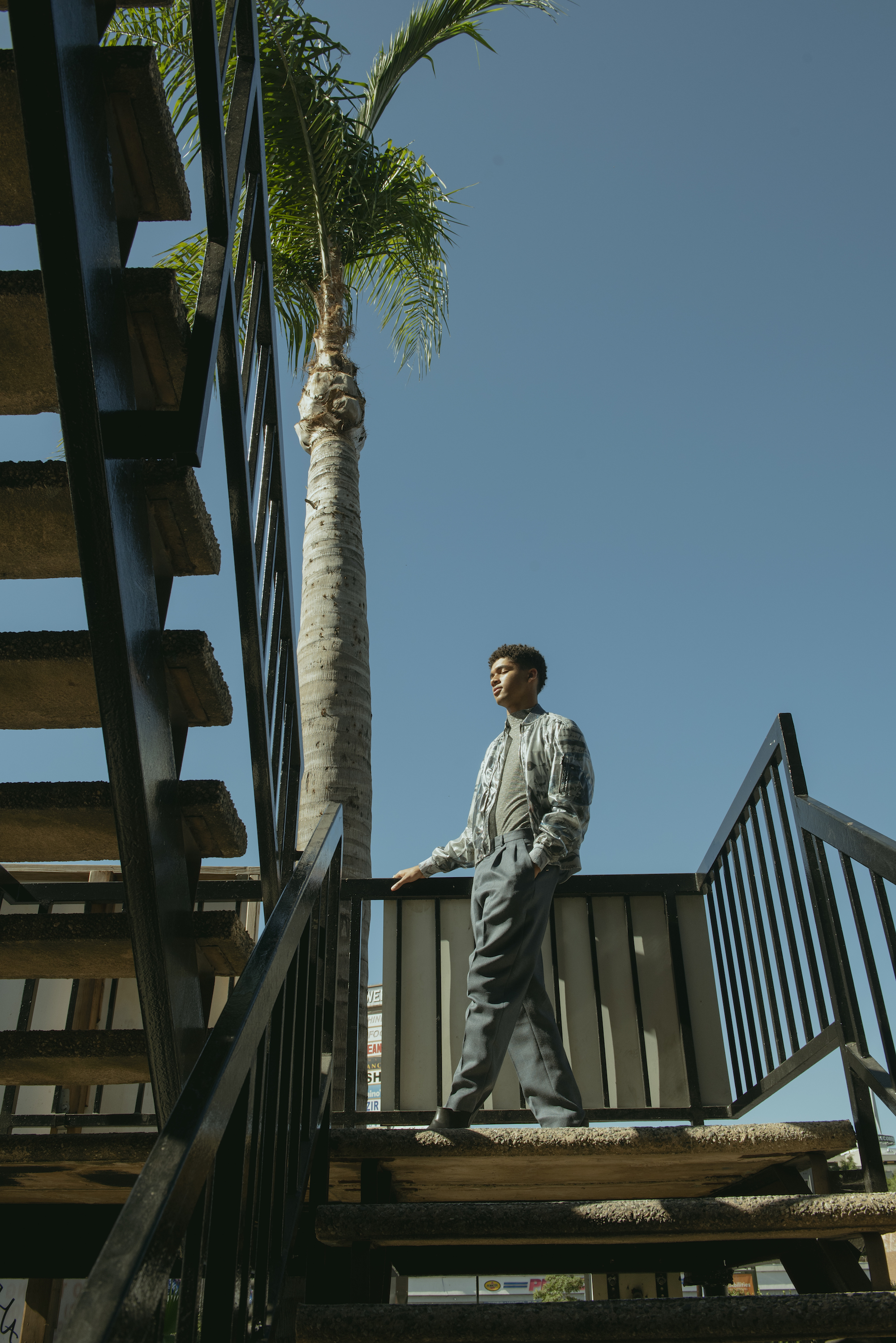 Asher Oyelowo fashion editorial palm tree