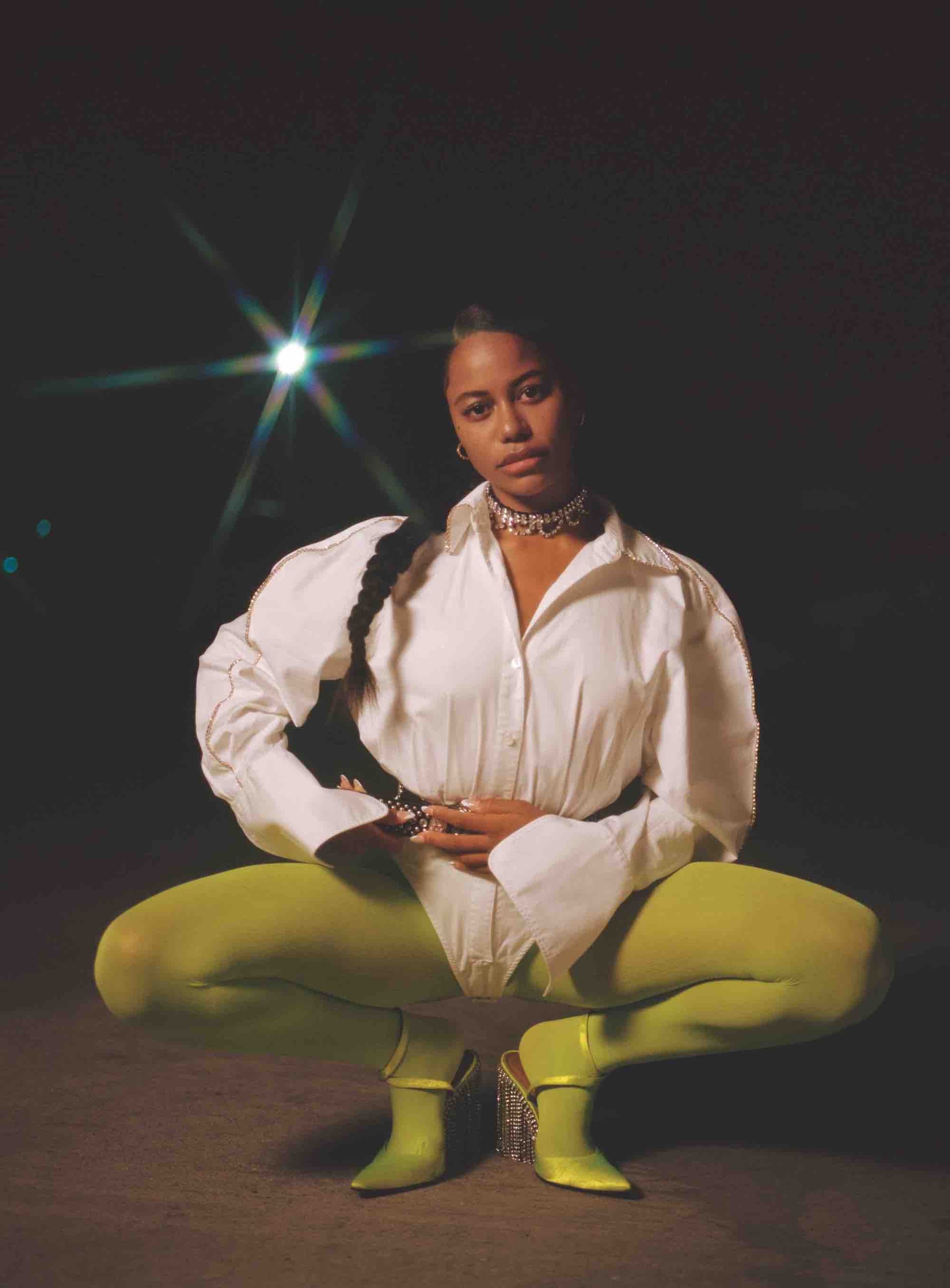 Zola actress Taylour Paige in the Winter issue of Wonderland green leggings