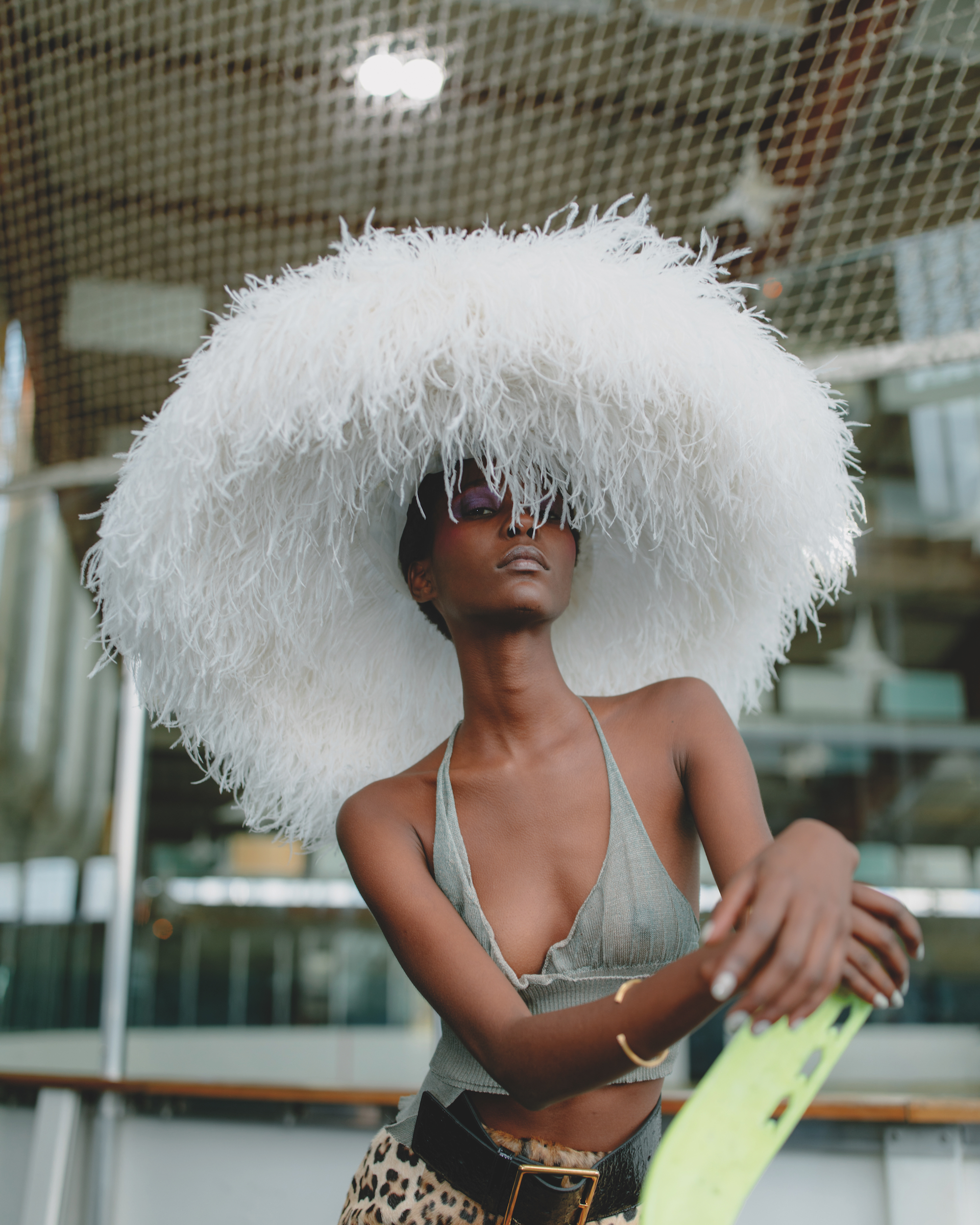 Spin around it's your white light fashion editorial from the Winter issue feather hat