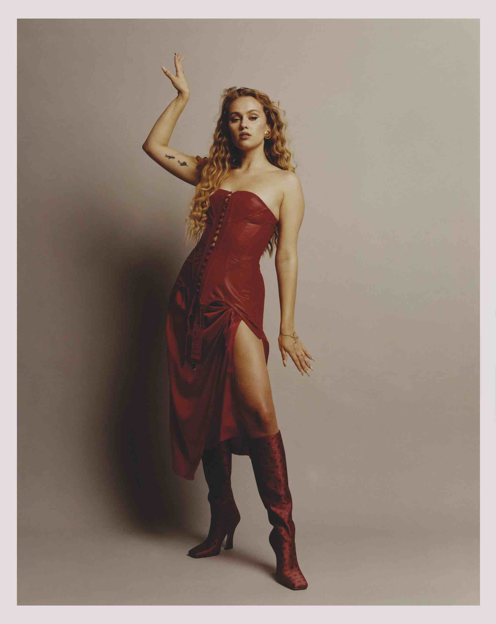 Sasha Keable in the Winter issue red dress