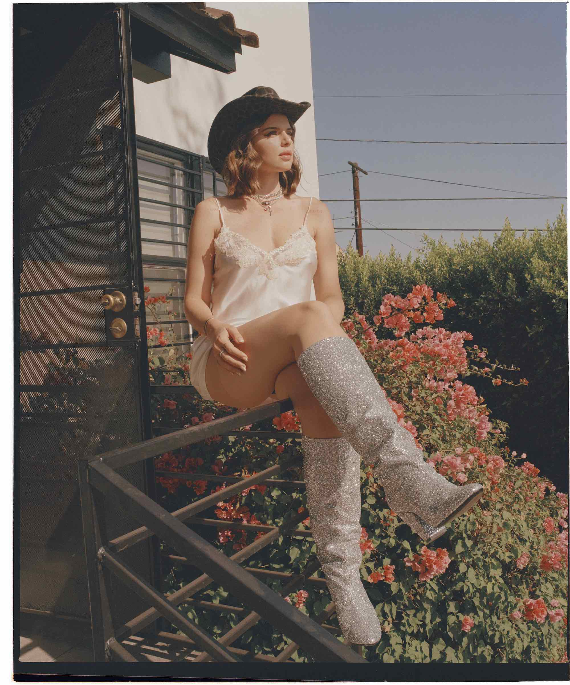 j Julia Fox in A24's Uncut Gems for the Winter issue of Wonderland cowboy hat