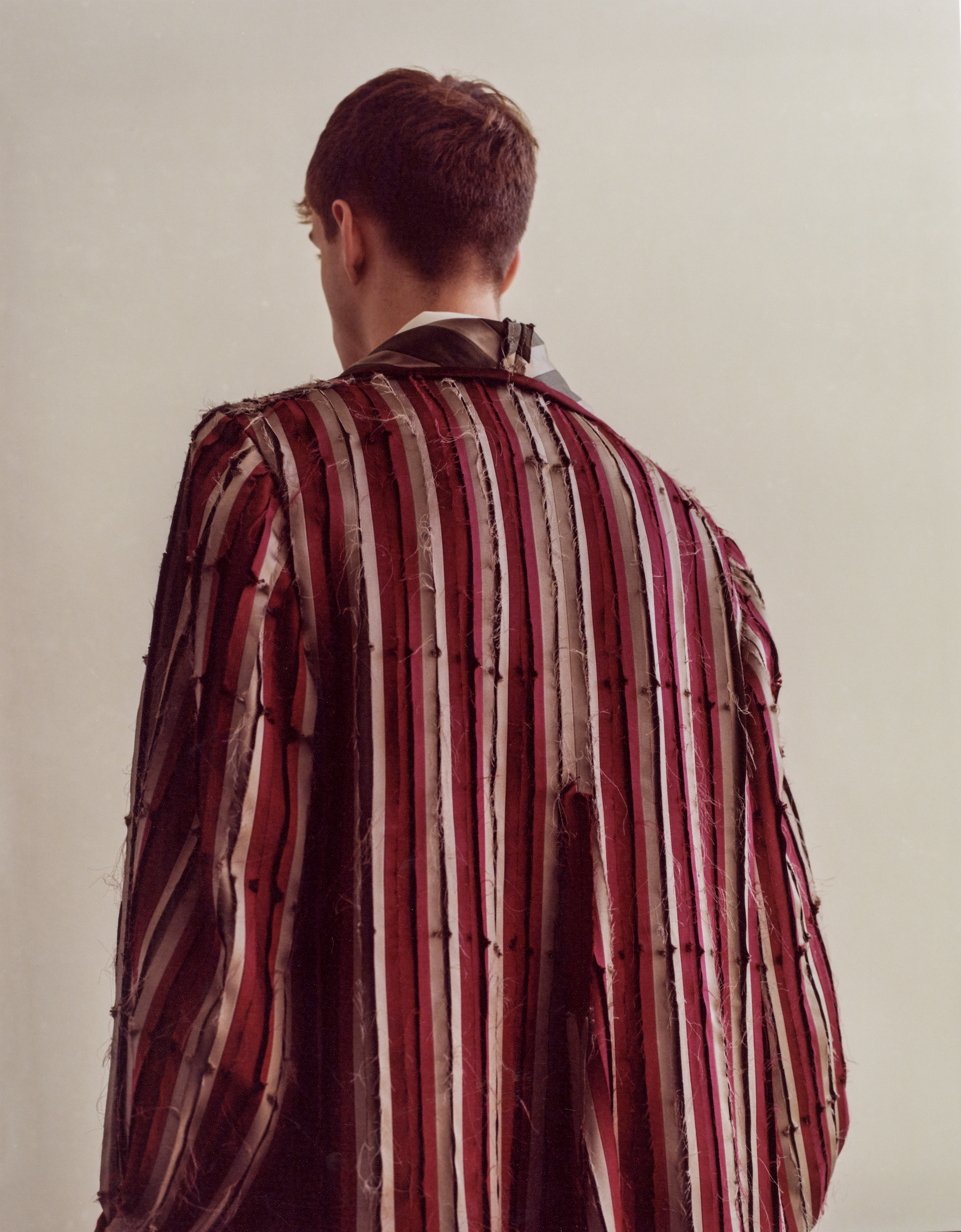 The 'Flyte' dressing gown is made up of 120 panels in three different silk qualities creating a striped appearance.