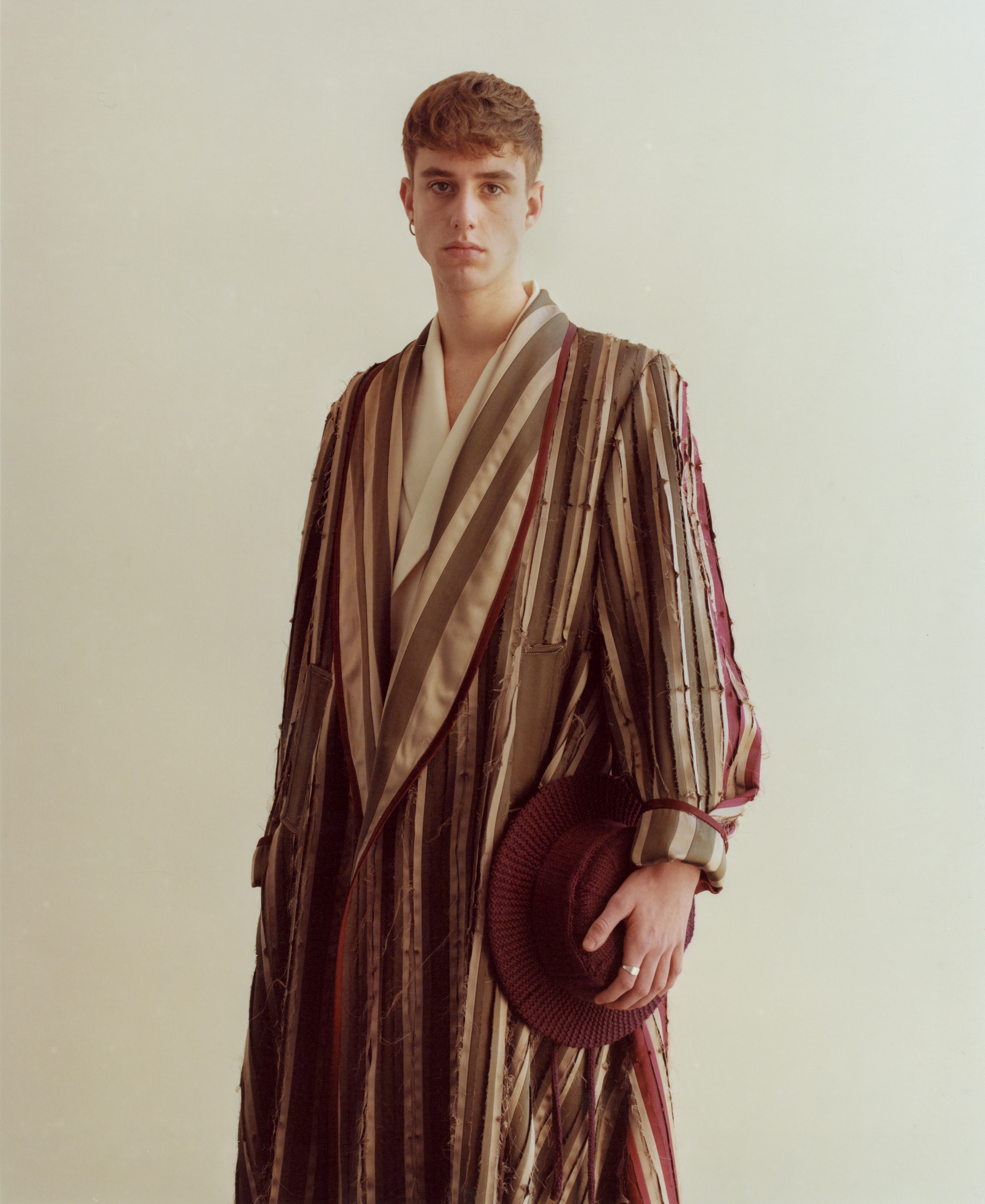 The 'Flyte' dressing gown is made up of 120 panels in three different silk qualities creating a striped appearance