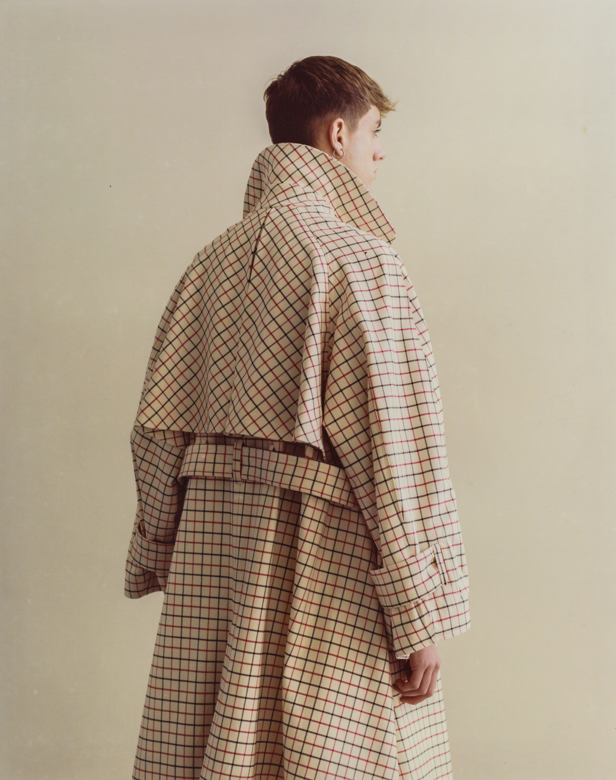 The 'Marlowe' wool tattersall check raglan trench coat has draped belted sleeves.
