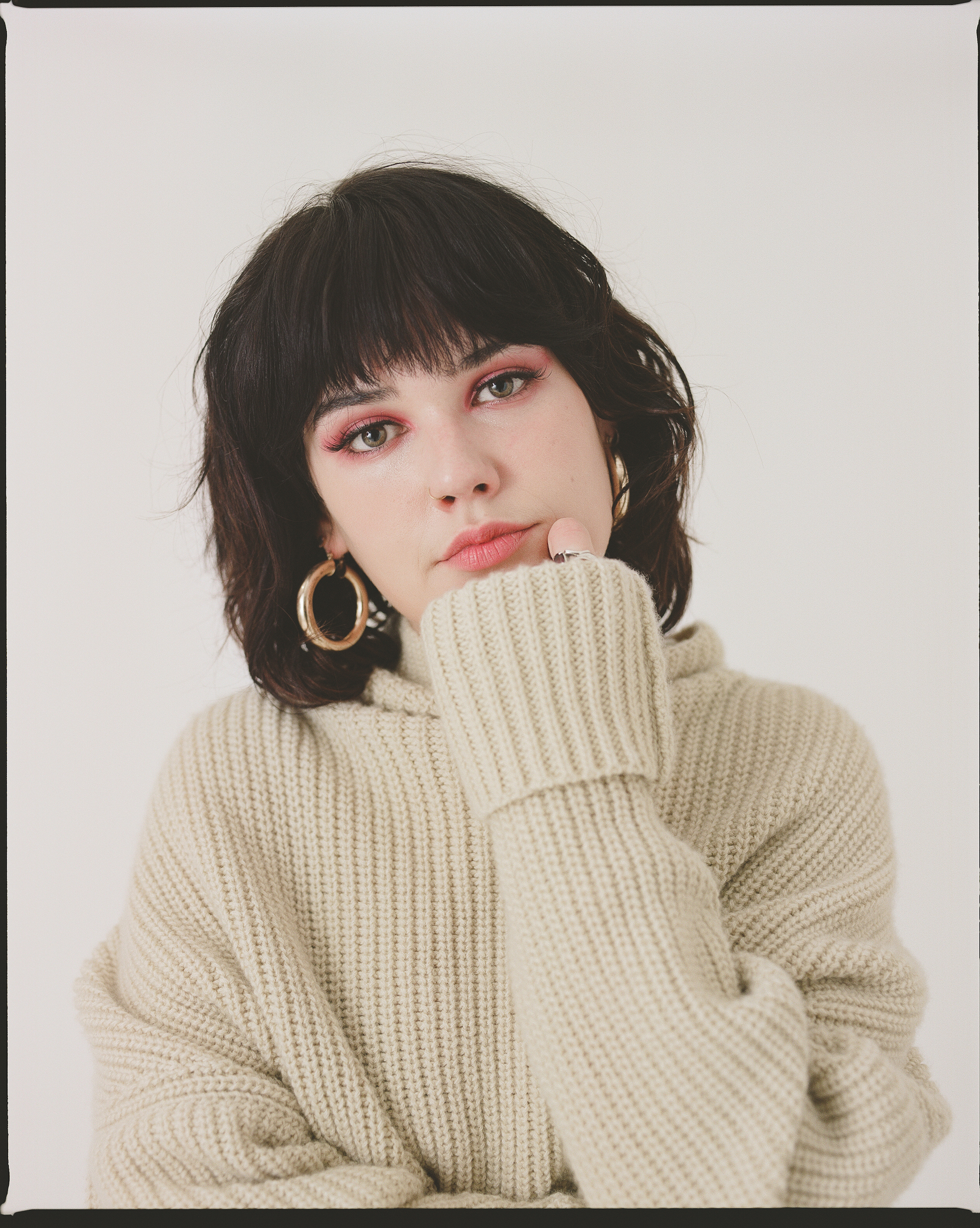 Lily more features in our spring issue wearing a thick beige jumper