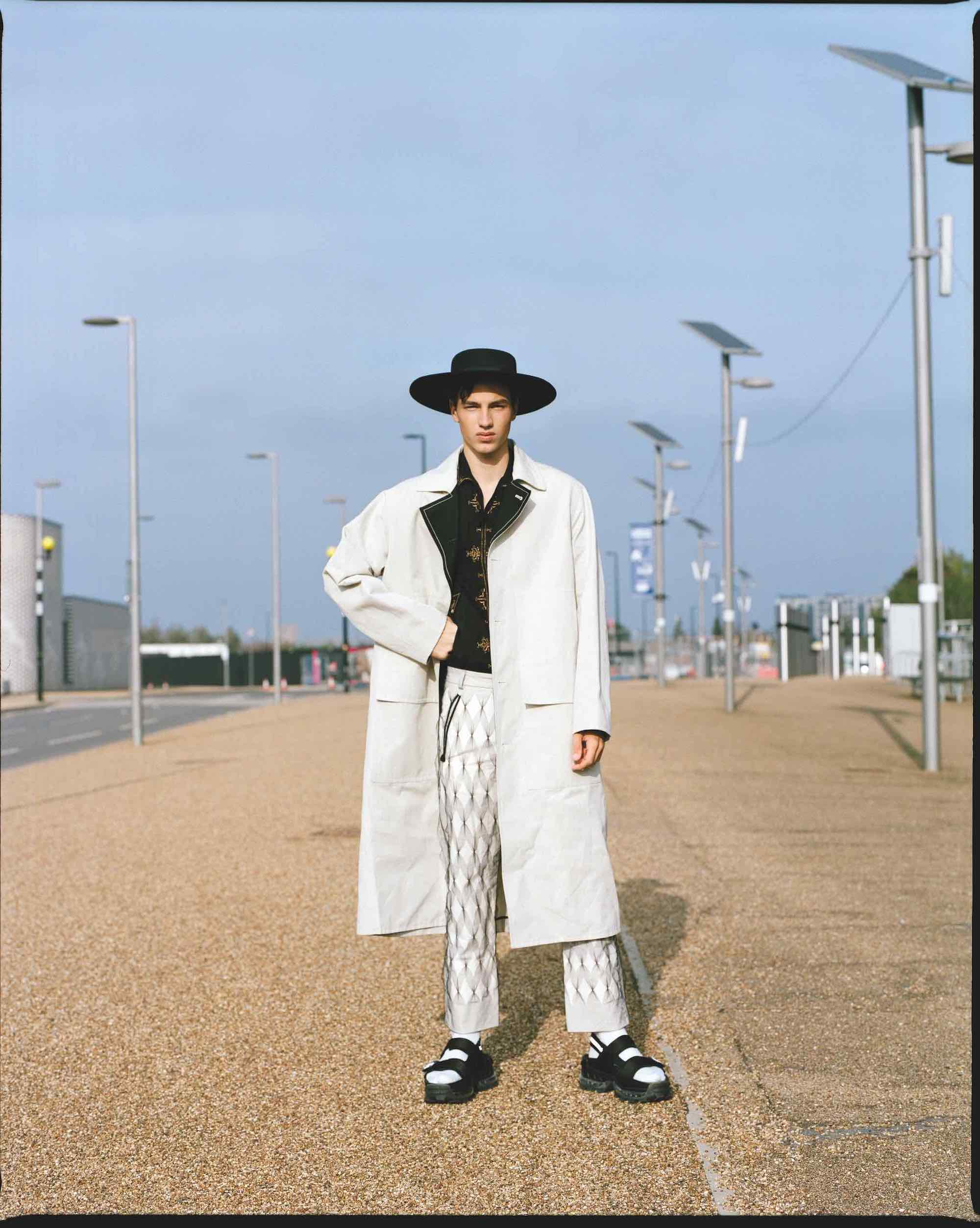 Are you down for the ride fashion editorial taken from our Spring issue black and white jacket and black hat