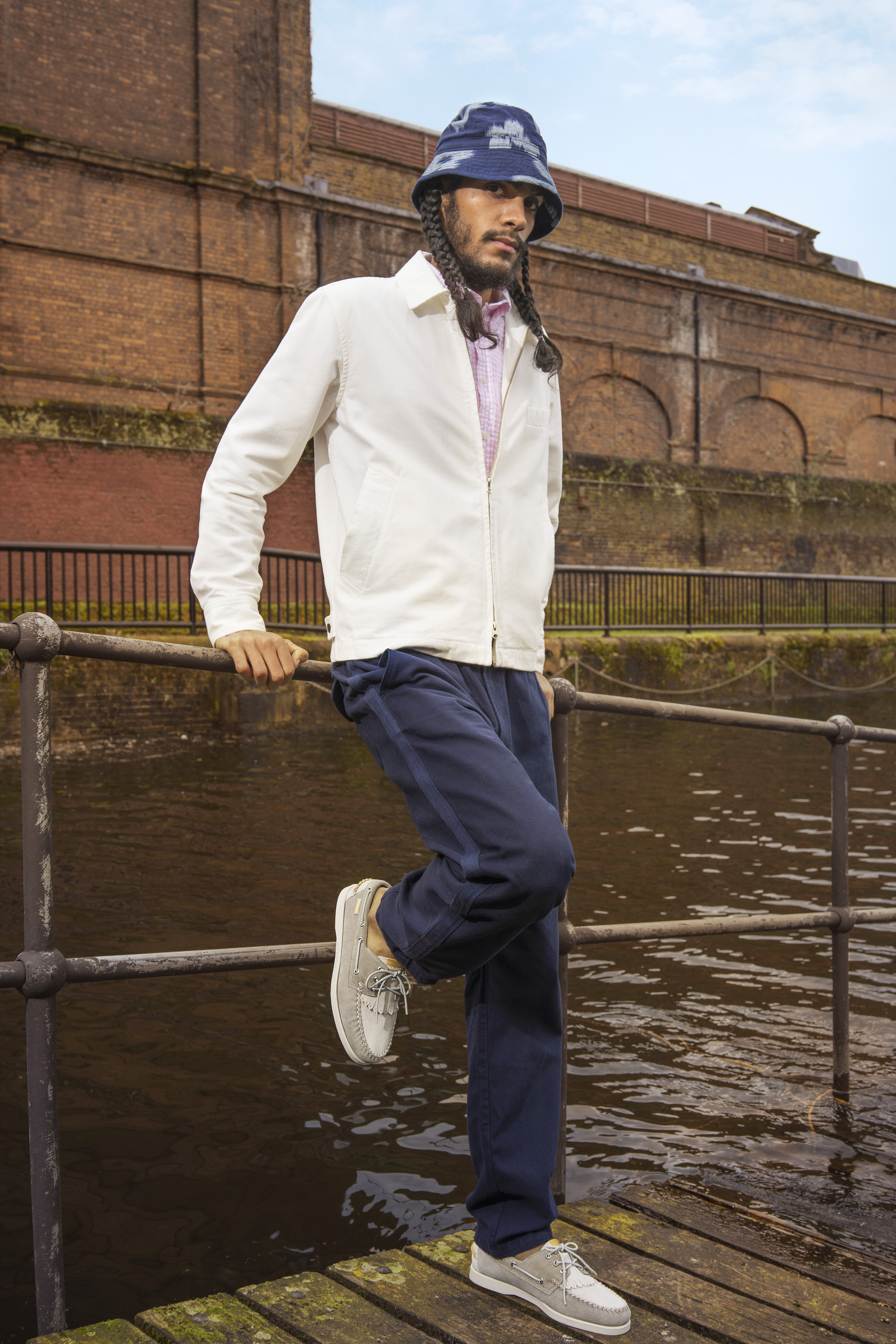 Universal x sabago collaboration for SS20 white jacket and grey two tone portland boat shoes