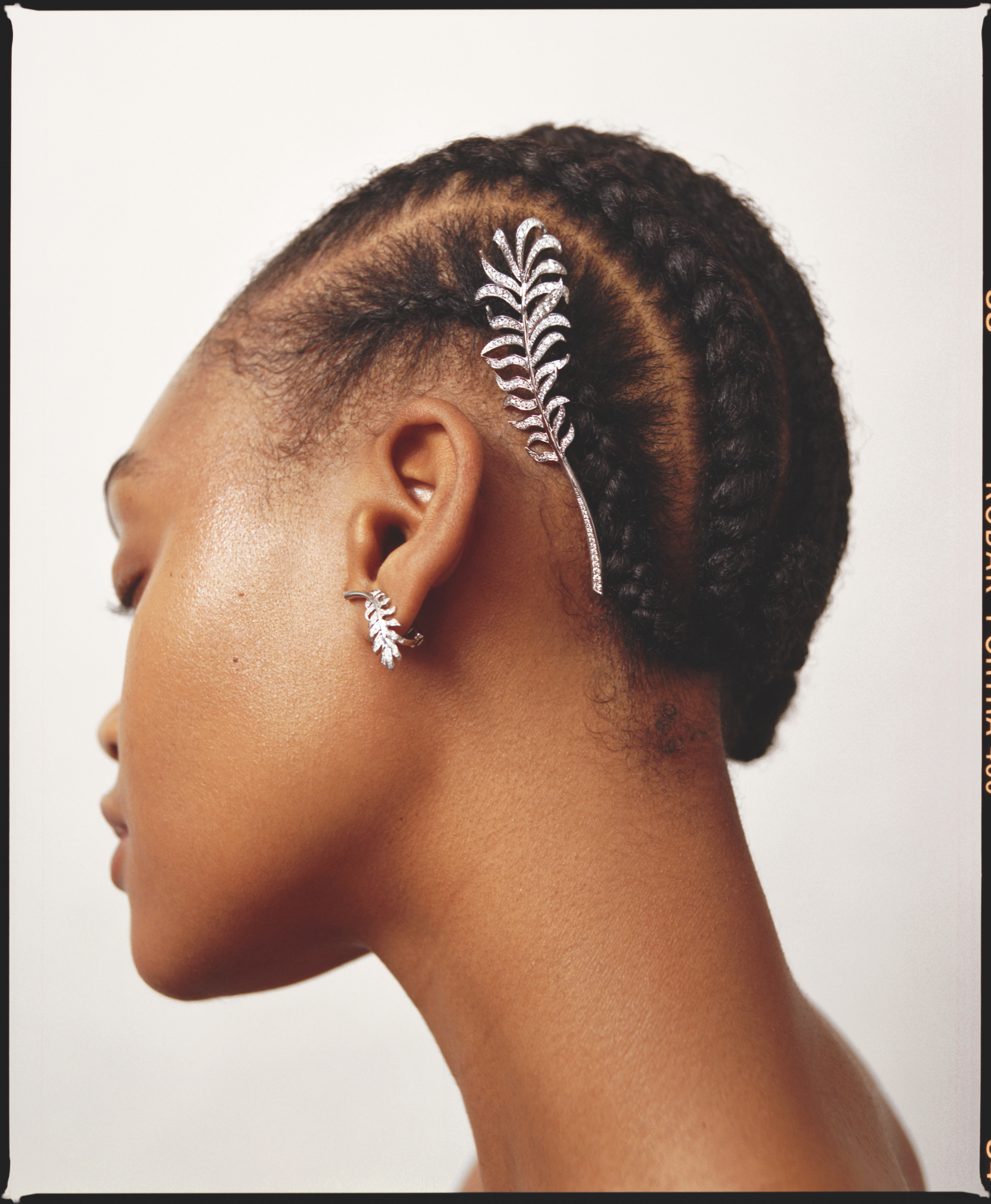 Chanel beauty features in our Spring issue feathers stone hair pin in braided hair