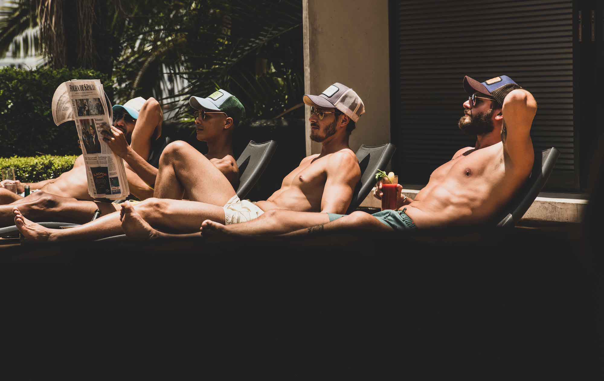 John Hatter & co are the brand new trucker hat company 4 men laying down wearing the hats