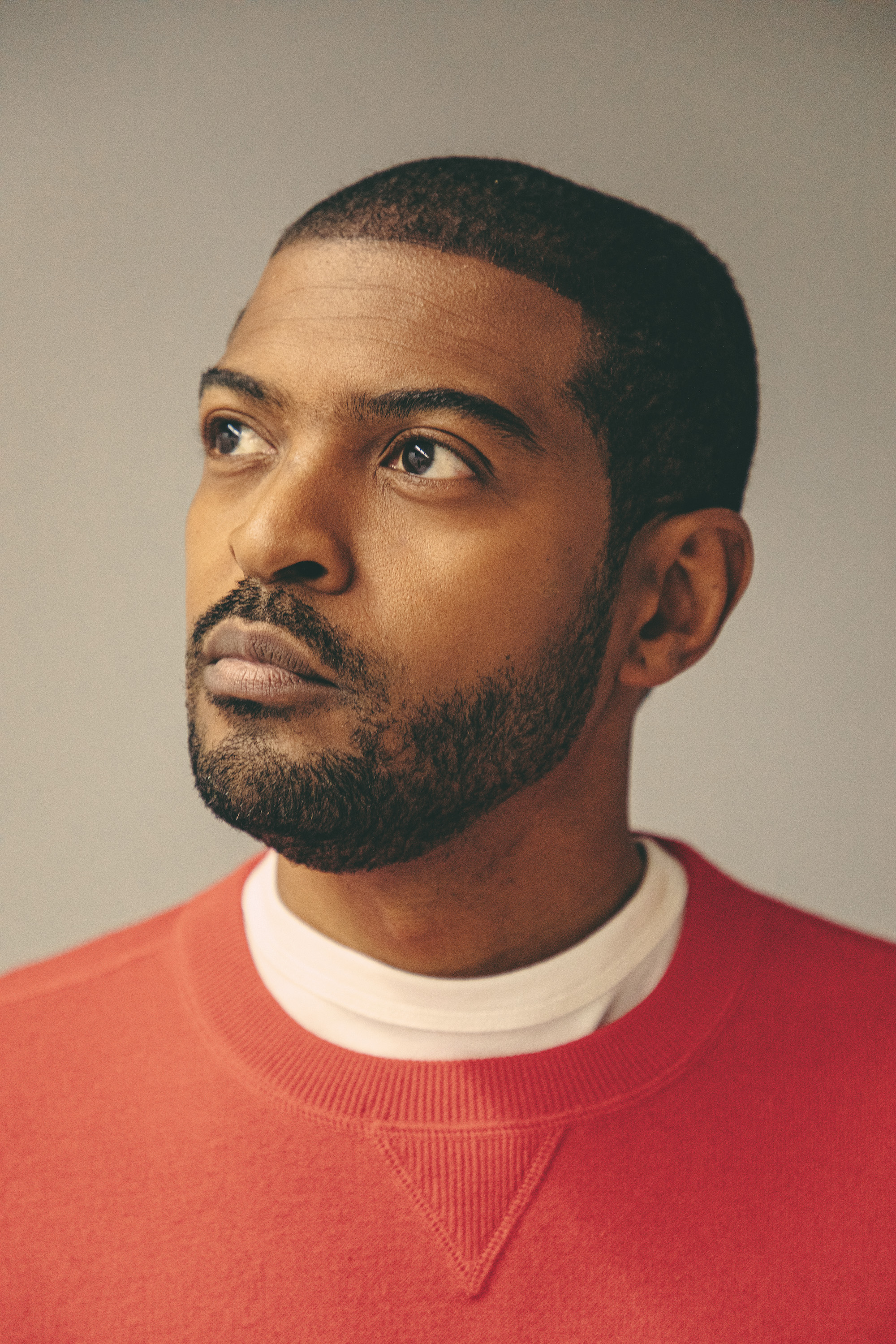 Noel Clarke wears red jumper and white t-shirt