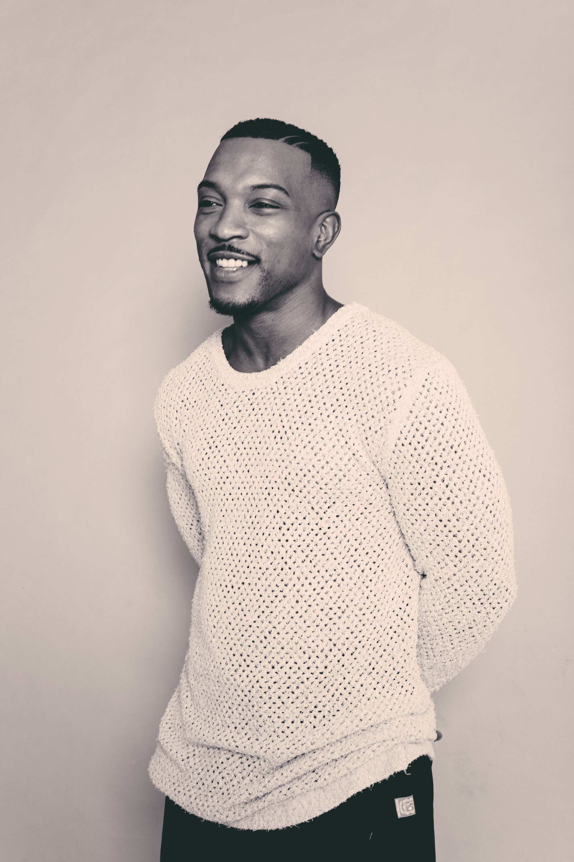 Ashley Walters in knitted white to