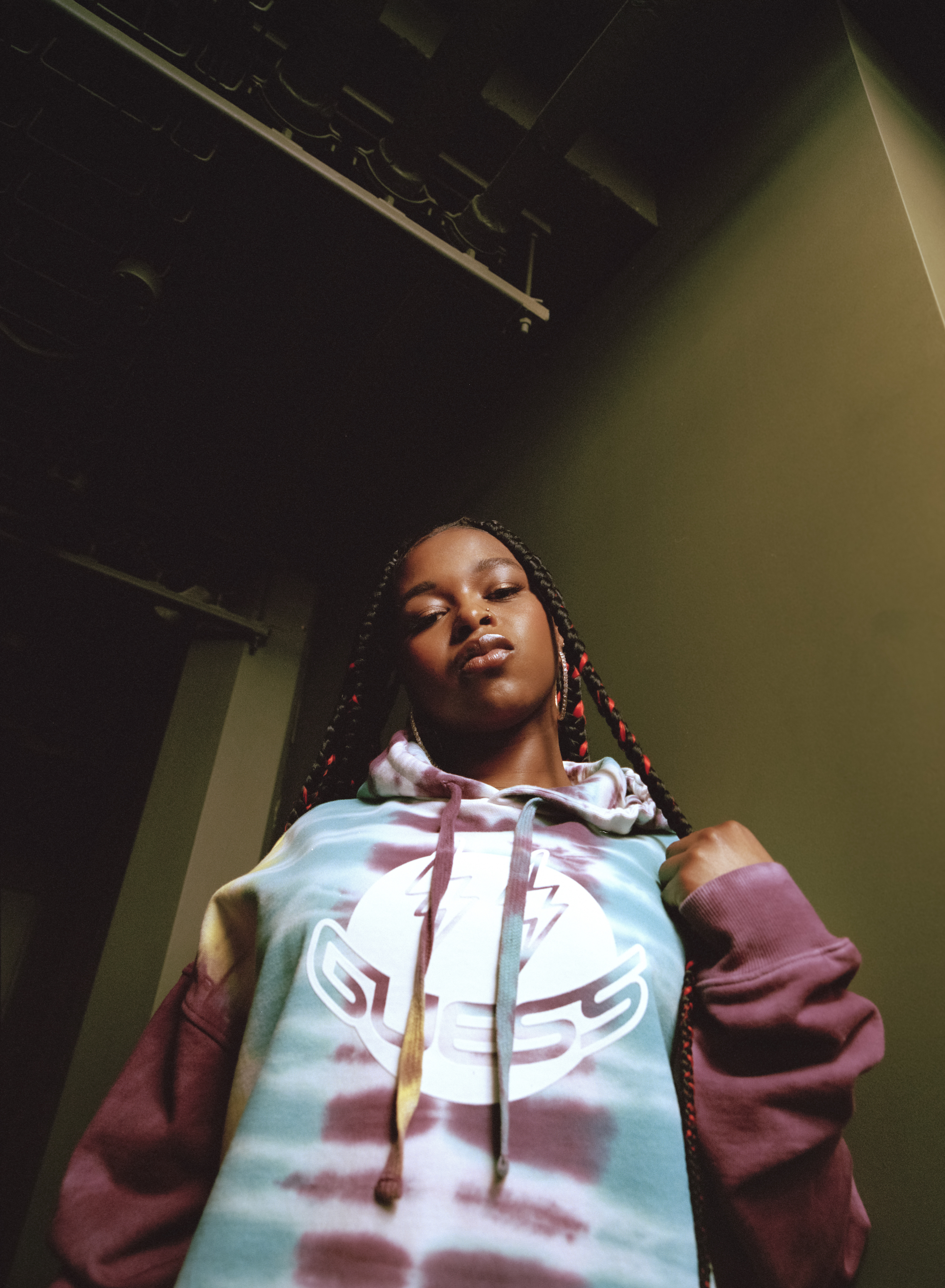 Nadia Rose wears multi coloured guess jumper