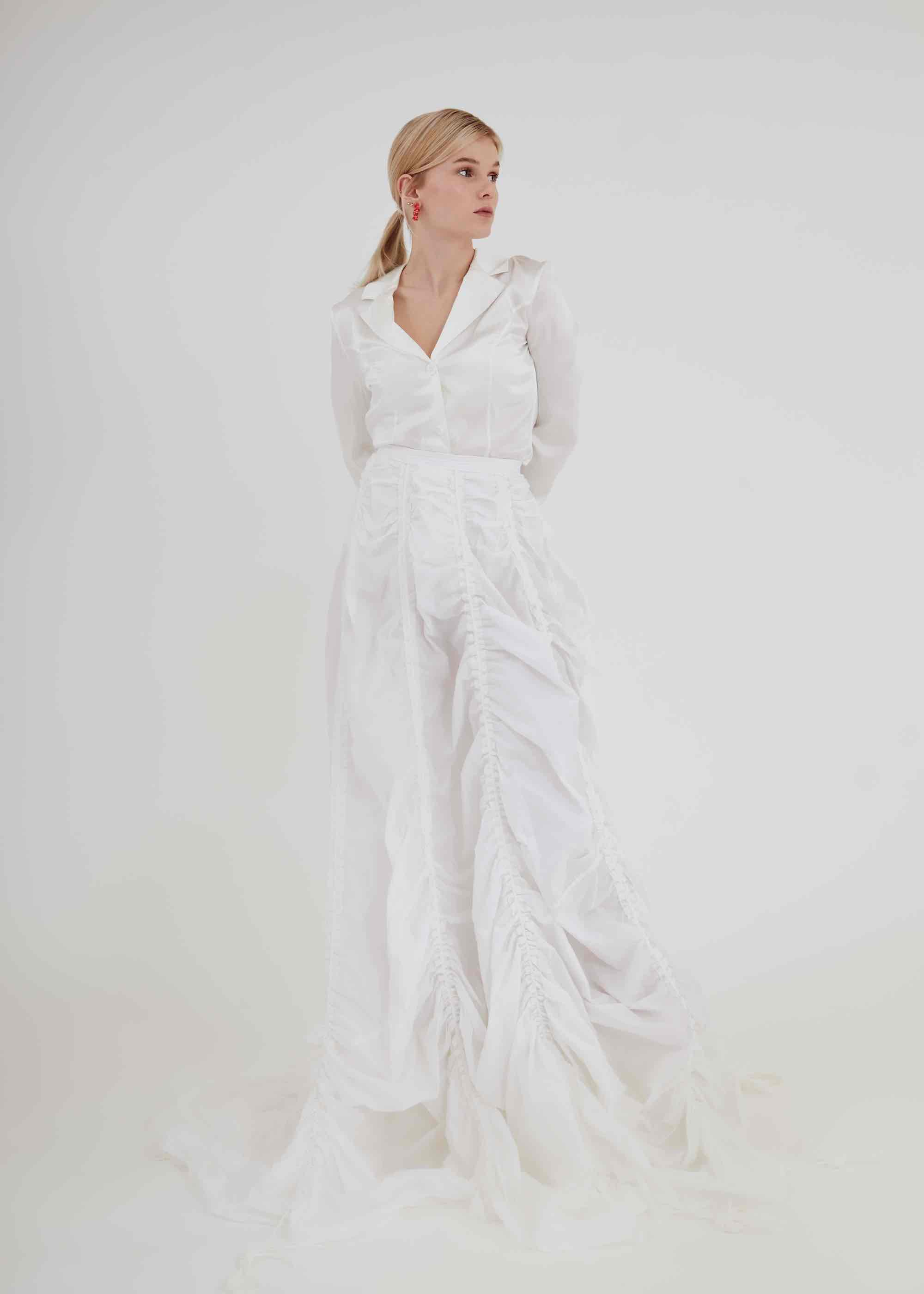Singer Nykki features in Rollacoaster wearing all white jump suit