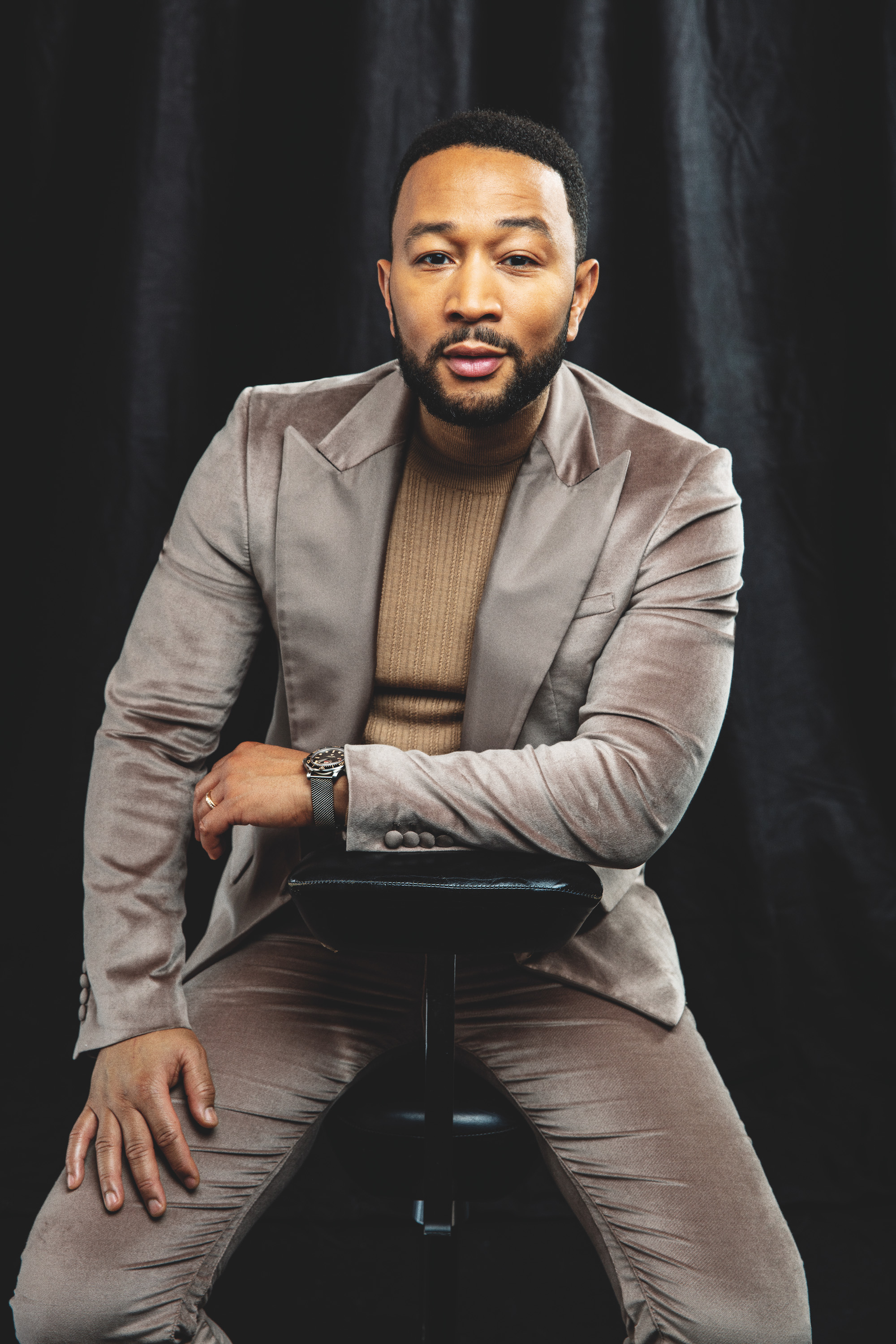 John Legend front rollacoaster SS20 issue wearing suit and polo kneck jumper