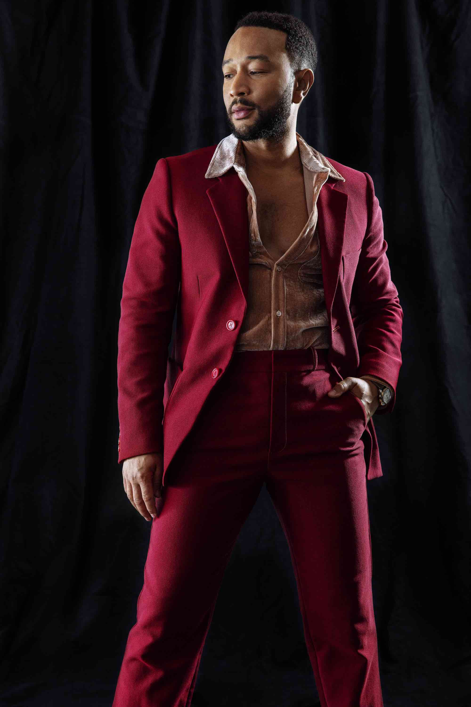 John Legend red suit with open suit