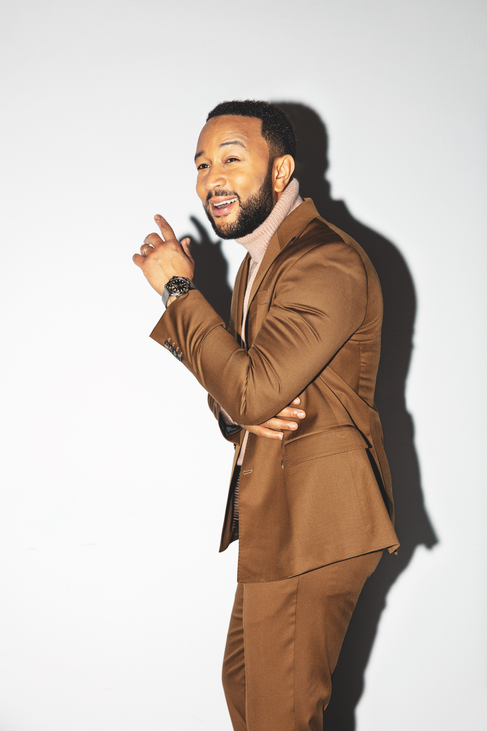 John Legend wears brown suit for Rollacoaster